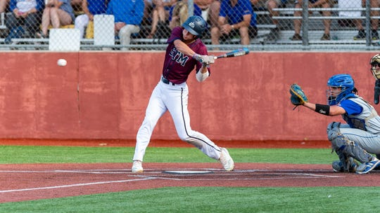 Josh Stevenson at the plate as St Thomas More takes on St Charles  in the Div II semi final round at the LHSAA State Championship. . Sunday, May 12, 2019.