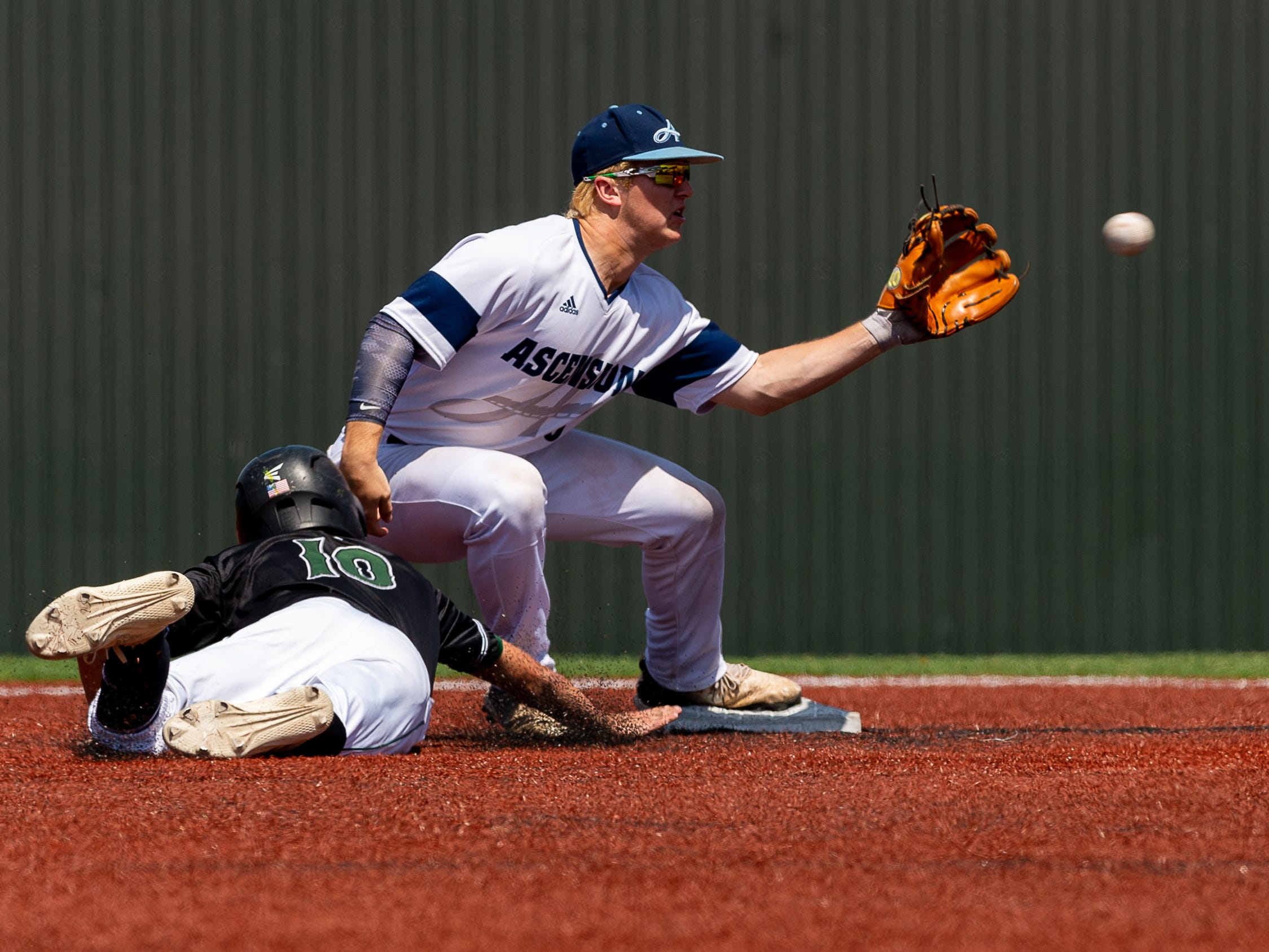 Seth Kerstetter covers second as Ascension Episcopal falls to Calvary Baptist Championship round at the LHSAA State Tournament. Monday, May 13, 2019.