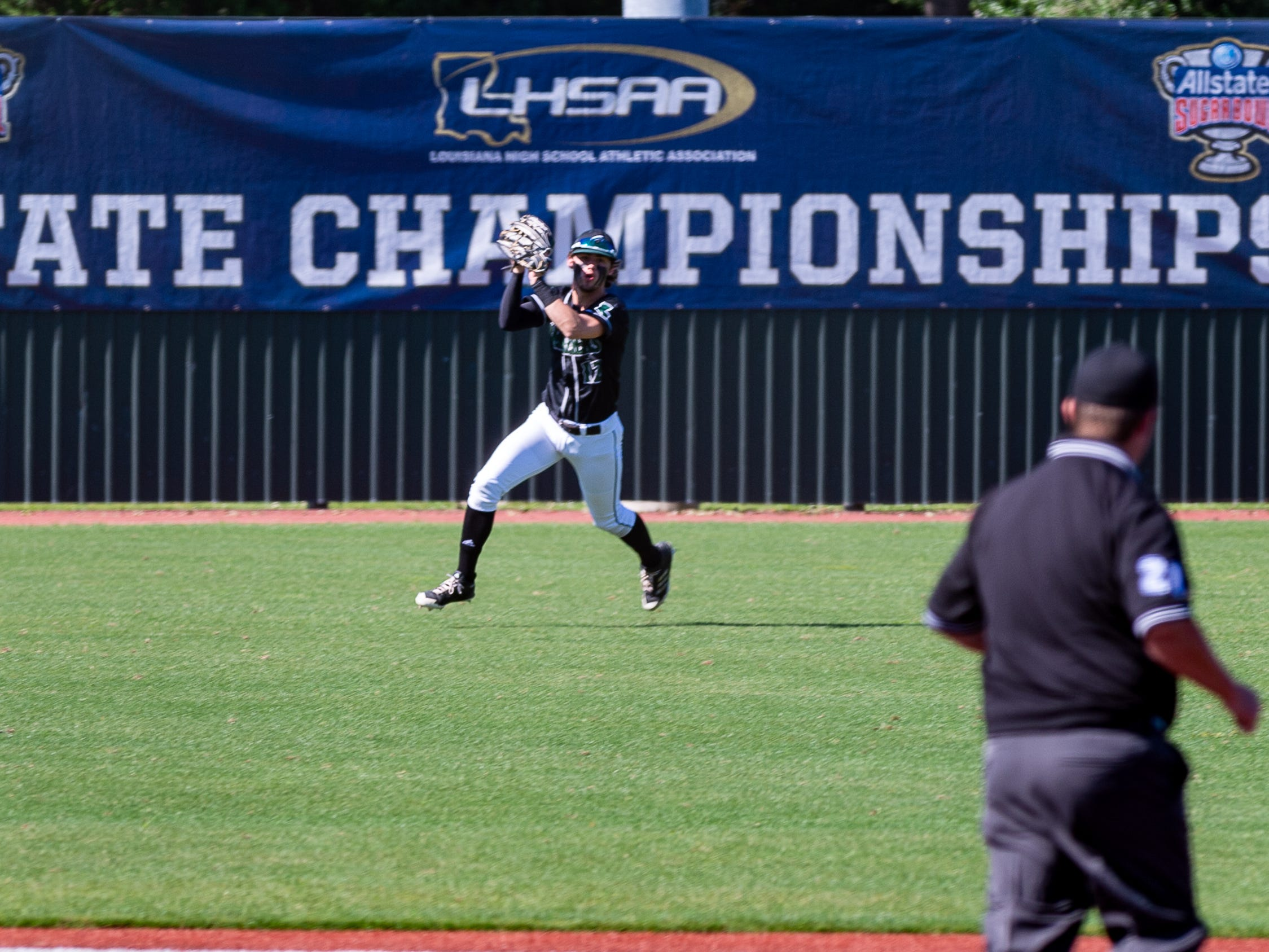 Michael Johnson hauls in a fly ball as Cade Hart on the mound as Calvary Baptist takes down Ascension Episcopalto win State Championship game at the LHSAA State Tournament. Monday, May 13, 2019.