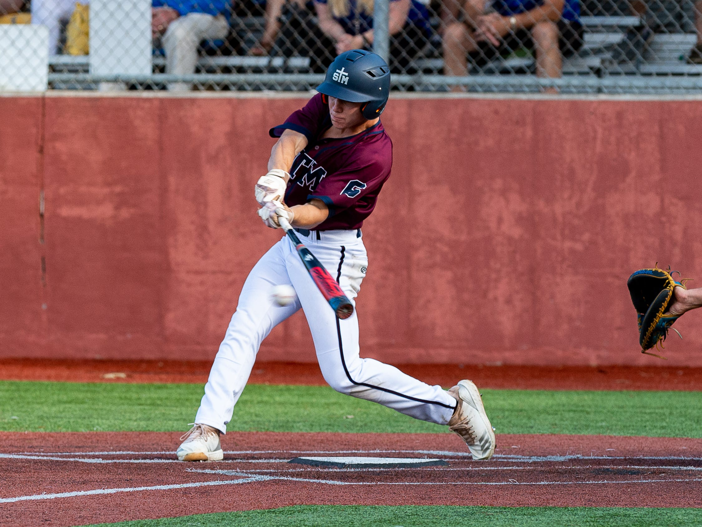 Will Cryer at the plate as St Thomas More takes on St Charles  in the Div II semi final round at the LHSAA State Championship. . Sunday, May 12, 2019.