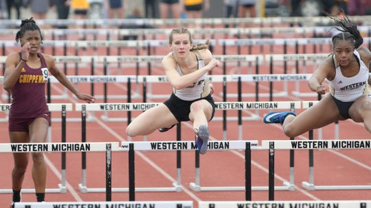 Brighton's Erin Dowd (center) repeated as 400-meter hurdles champion for Western Michigan at the Mid-American Conference outdoor track and field meet in Muncie, Ind.
