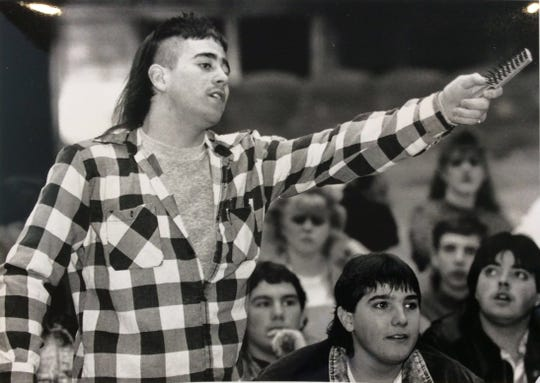 Eastern High School student Scott Van Deusen asks a question during a sit in protest in March of 1990. The protest was in reaction to new school policies on attendance and dress code.