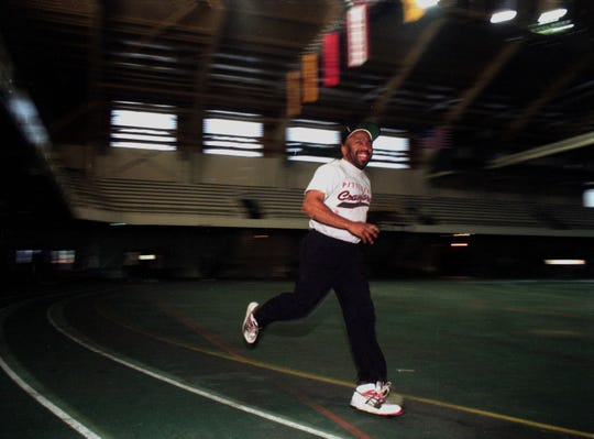 Longtime WKAR radio personality Earle Robinson loved to stay in shape. This is a 1996 photo of him running at MSU's Jenison Fieldhouse.