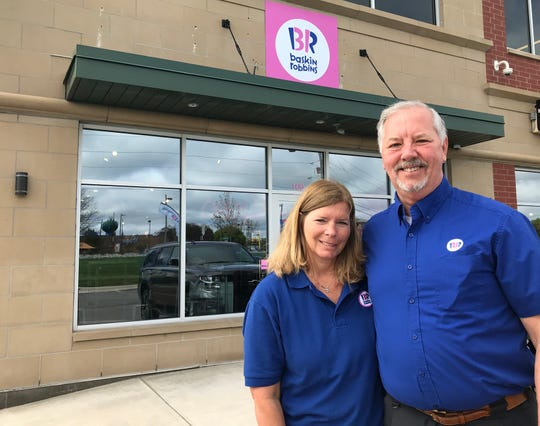 April and Tom English in front of their second Lansing-area Baskin Robbins store on West Lake Lansing Road in East Lansing. The store opened last week.