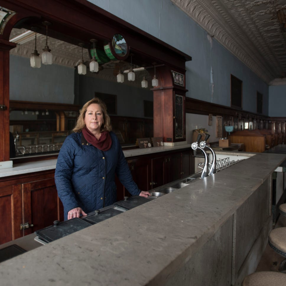 Heather Hanover inside the future home of Hanover's Michigan Mints on North Clinton Avenue in downtown St. Johns.  The building was formerly the Sugar Bowl, which closed in 1970.