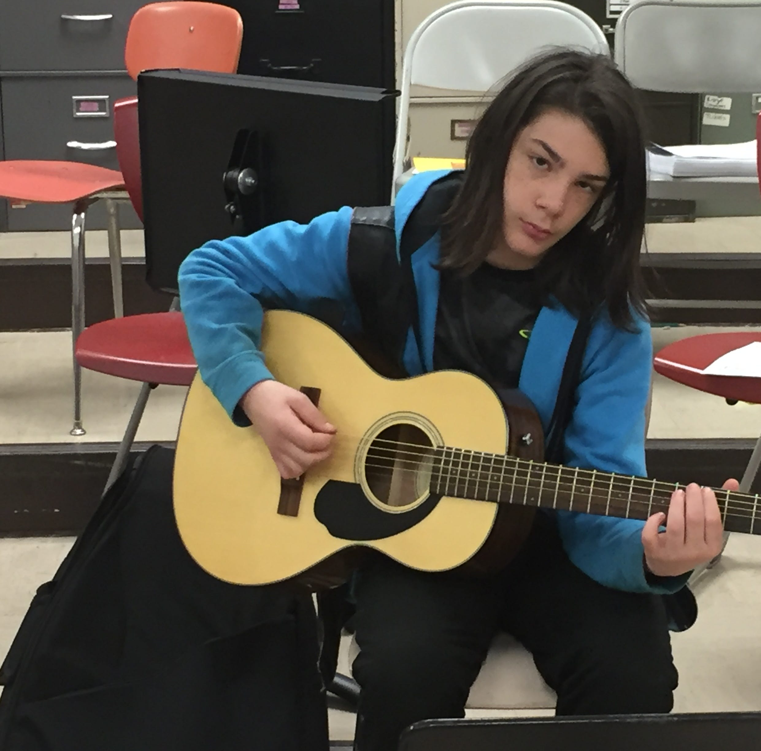 Shelby Middle School students learning guitar