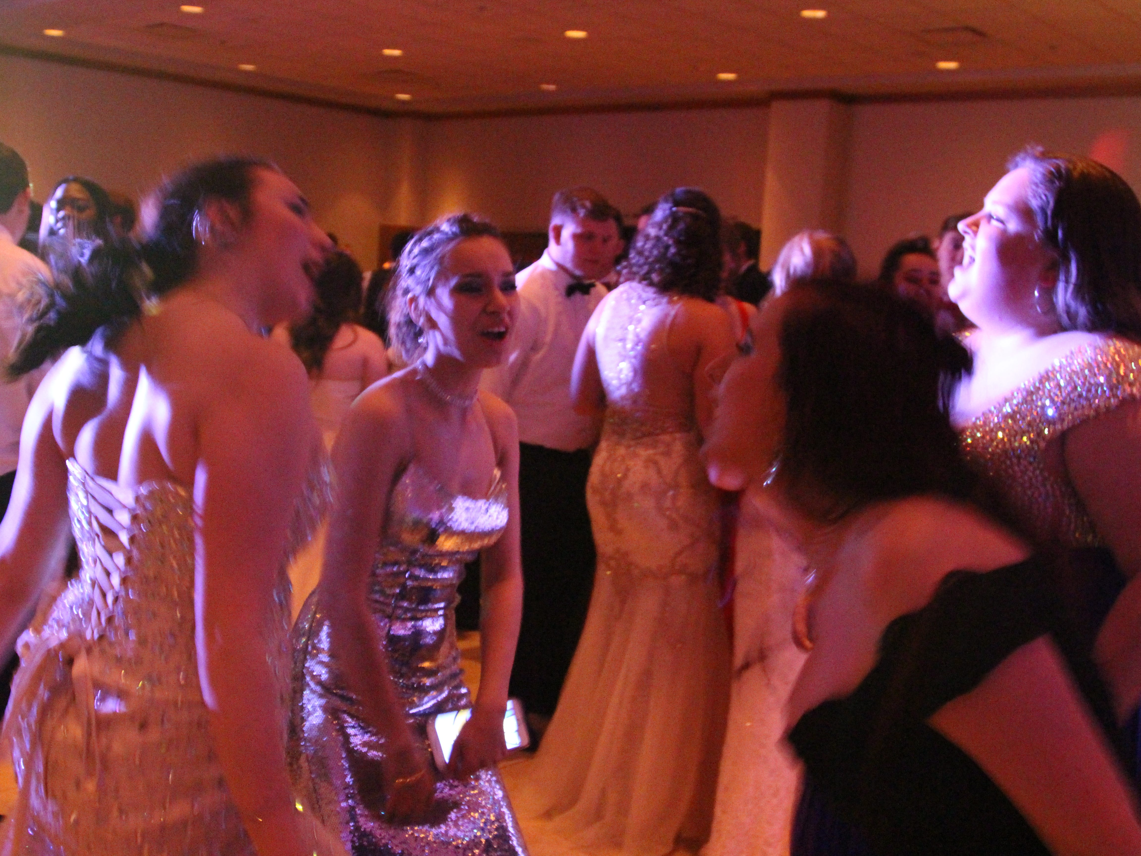 Sierra Tillman, left; Leila Kaser, middle; Lauren Young; and Jacquelynne Haycox, far right, dance Saturday at Marion Harding High School's prom at the Marion Palace Theatre's May Pavilion.