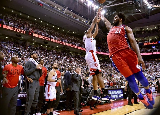 76ers center Joel Embiid (21) fails to stop Toronto Raptors forward Kawhi Leonard's last-second basket in Game 7.