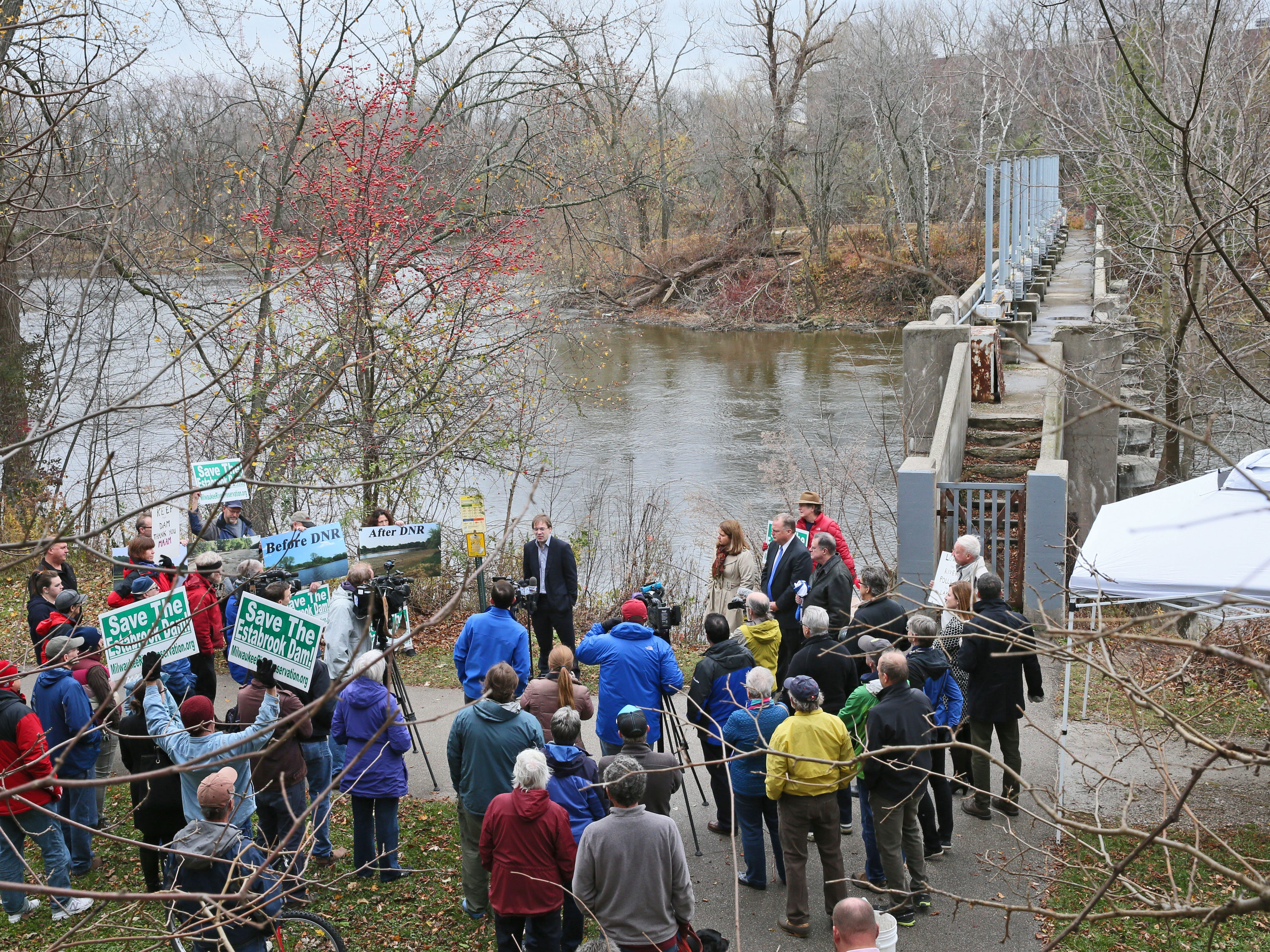 2015: Members of Milwaukee Riverkeepers and Milwaukee County Executive Chris Abele held a press event urging removal of the Estabrook Dam on the Milwaukee River just south of Hampton Ave.  A group of people from Milwaukee River Preservation Association who hold the opposite view stood to the side and held signs that urged the dam be saved.