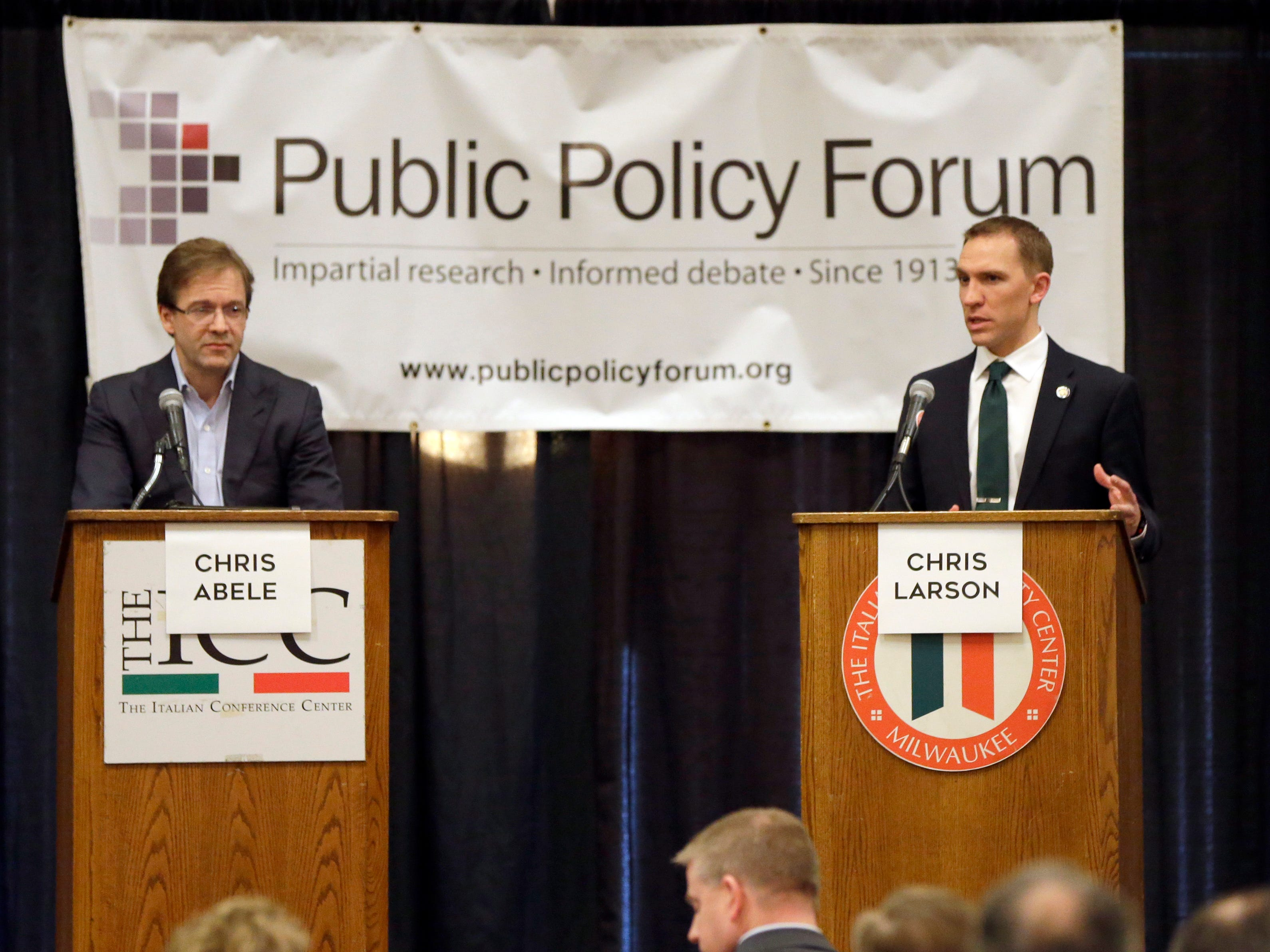 2016: Milwaukee County Executive incumbent Chris Abele (left) listens as challenger Chris Larson speaks during a debate. The Milwaukee County Executive candidates debated at  the Italian Conference Center, 631 E. Chicago St., in Milwaukee. Abele is seeking re-election to a second full four-year term.