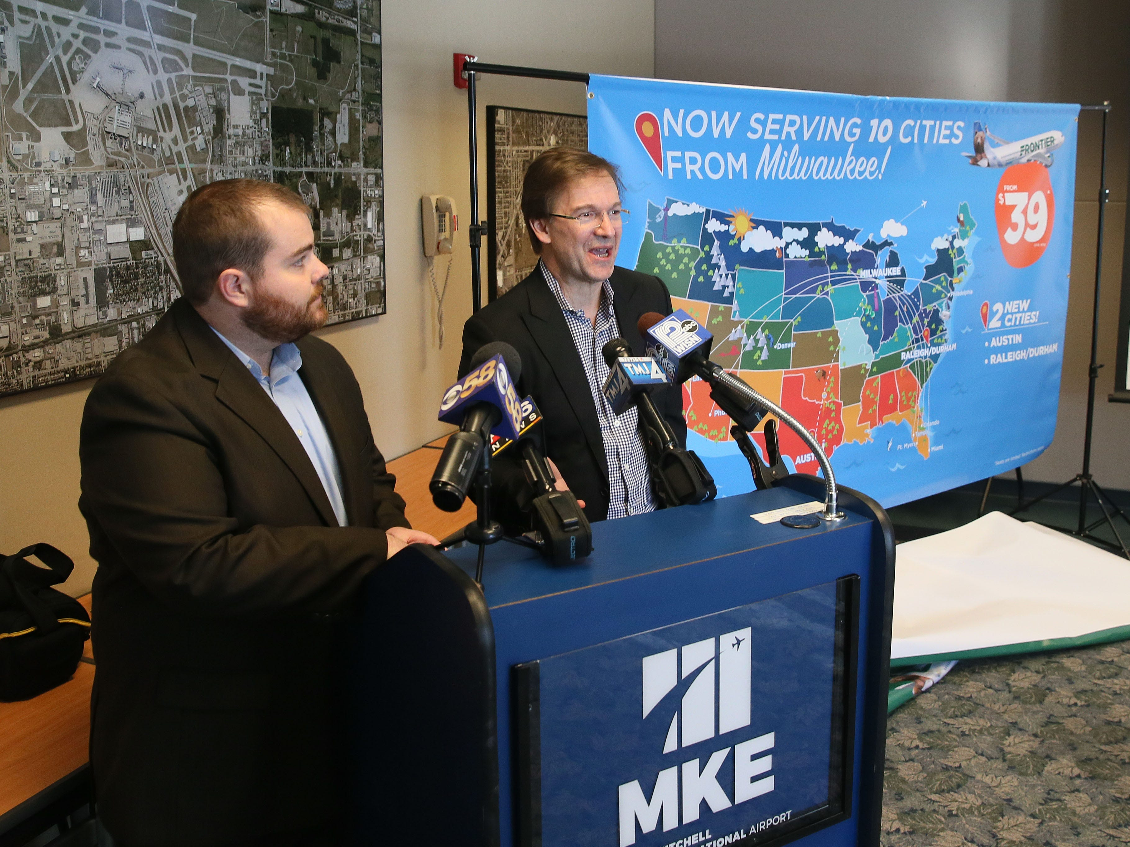 2018:  Milwaukee County Executive Chris Abele was on hand to hear Frontier Airlines, director of planning and commercial analysis Seth Neuschwander (left) announce new flights to Austin and Raleigh-Durham  from Milwaukee General Mitchell International Airport.
