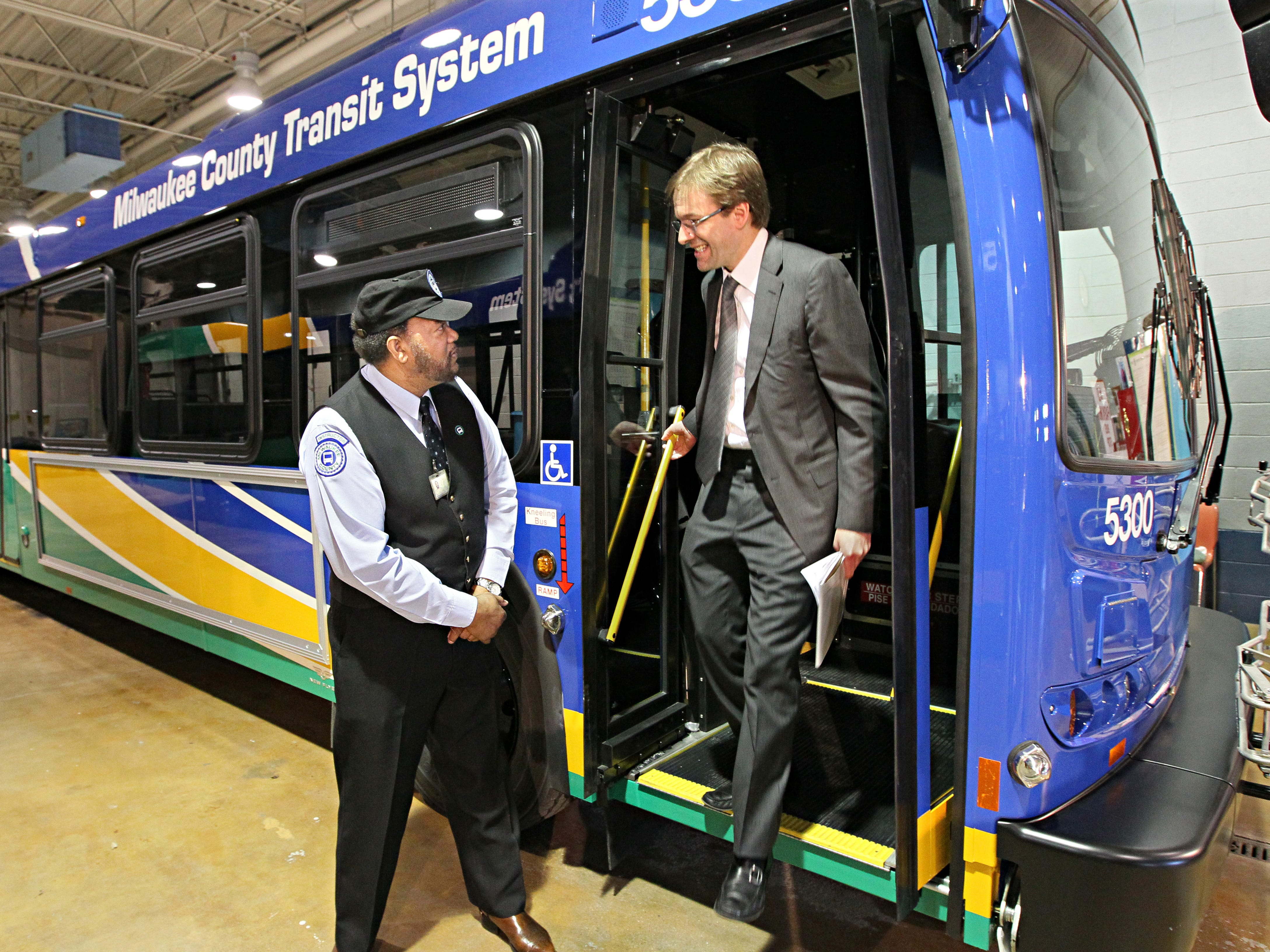 2012: The first of the 136 new clean diesel buses continue to arrive and are being put into service by the Milwaukee County Transit System. Milwaukee County Executive Chris Abele checks out the clean diesel bus and chats with MCTS bus driver Leodis Hentz (left) before he heads out onto his route with the new bus.