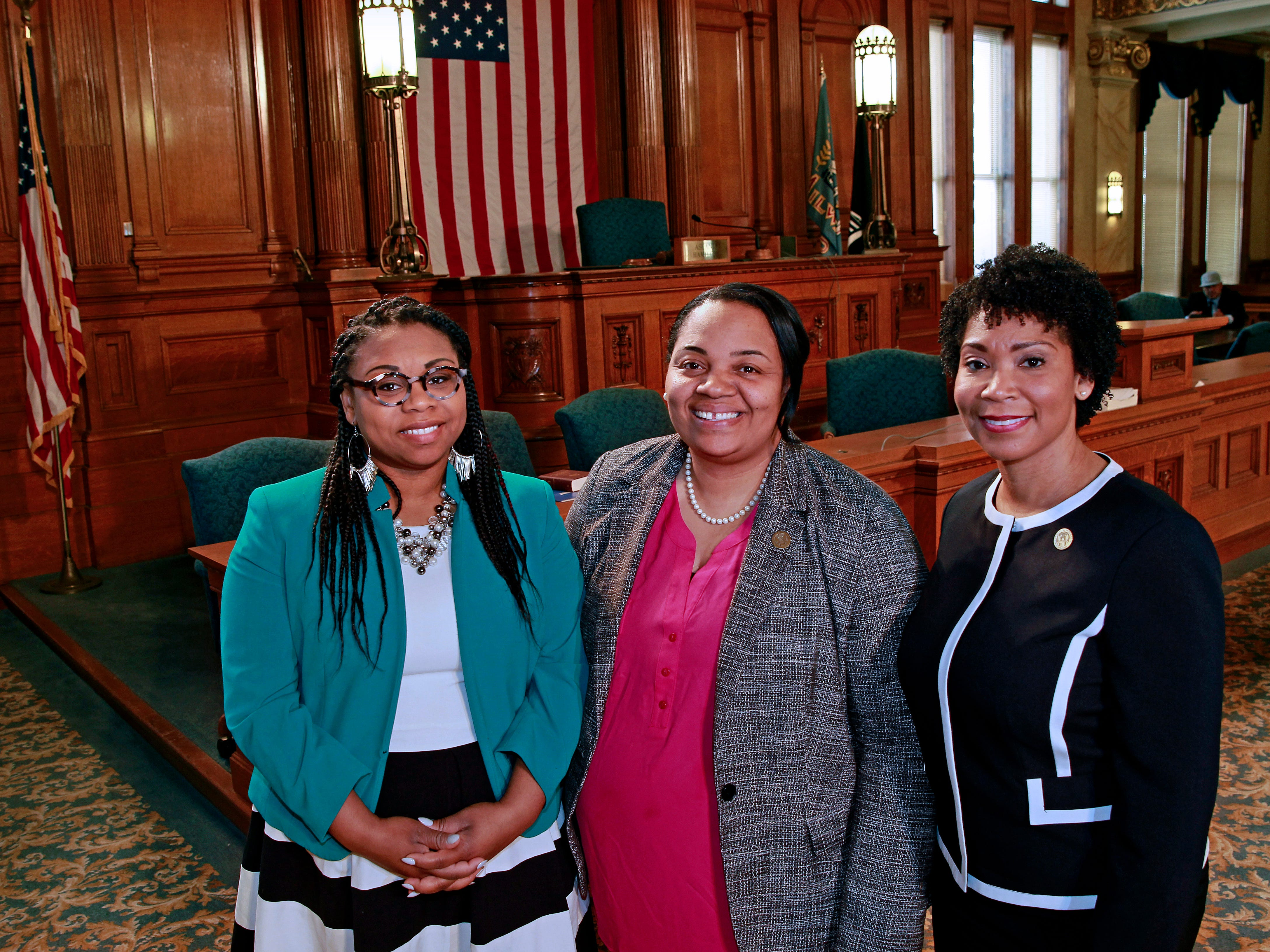 Milwaukee Alderwomen from left,  Chantia Lewis, Milele Coggs and Nikiya Dodd in the Common Council chambers at Milwaukee City Hall.