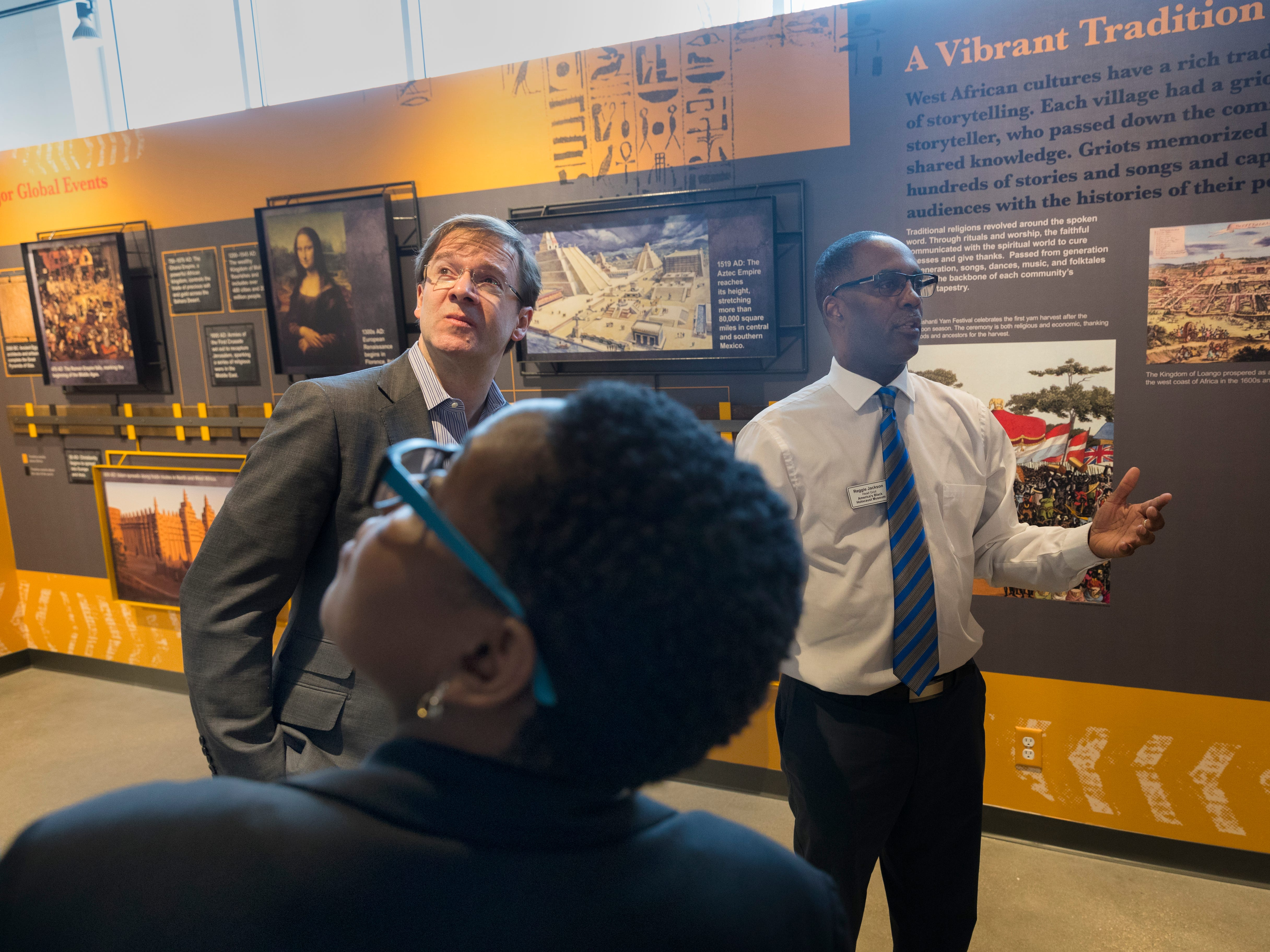 Head griot Reggie Jackson (right) of America's Black Holocaust Museum at 401 W.North Ave. in Milwaukee gives a tour to Milwaukee County Executive Chris Abele and others. The museum plans on reopening to the public later in the year.