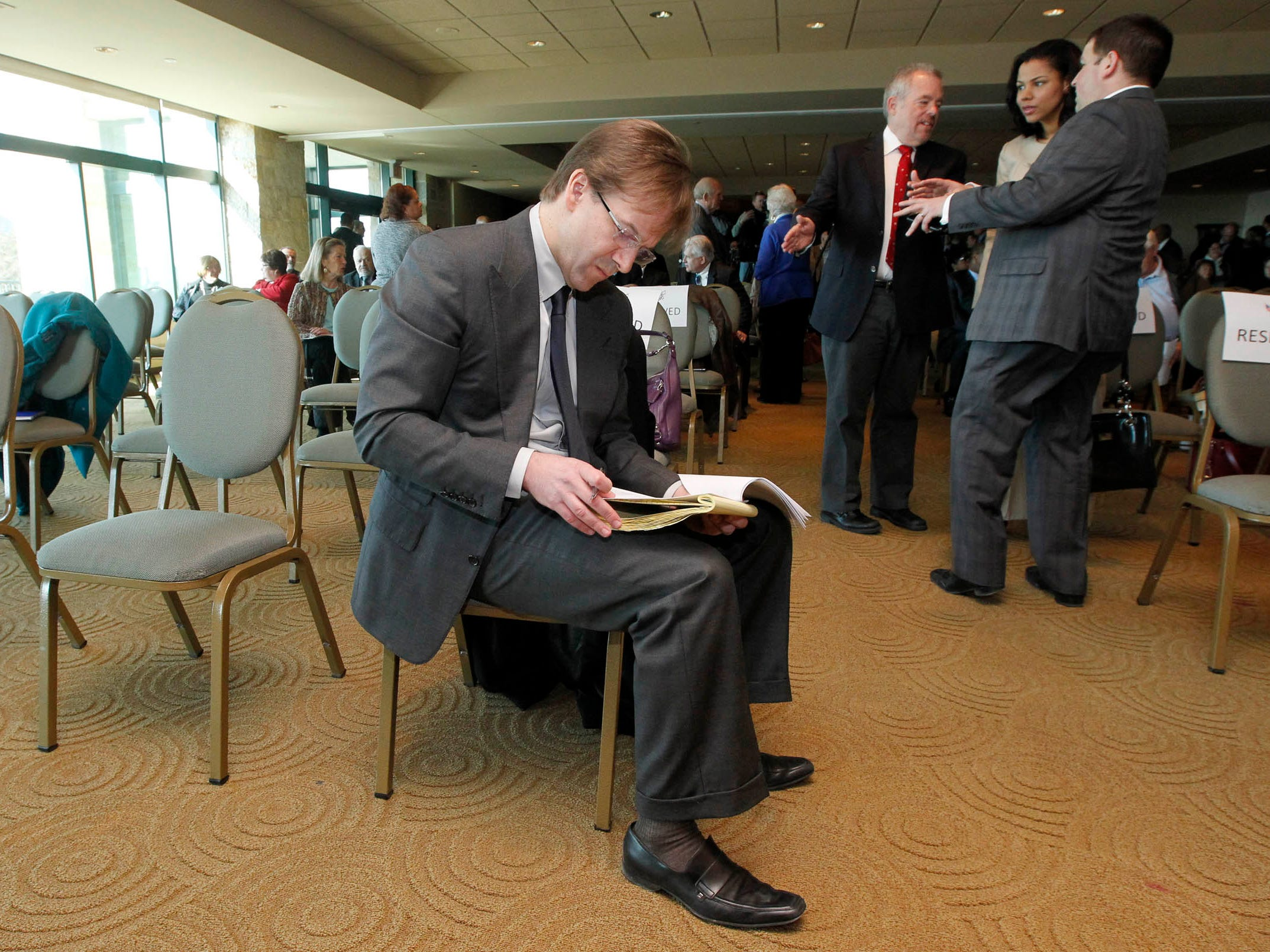 2014: Milwaukee County Executive Chris Abele looks over his notes before his State of the County speech in Miller Pavilion at O'Donnell Park.