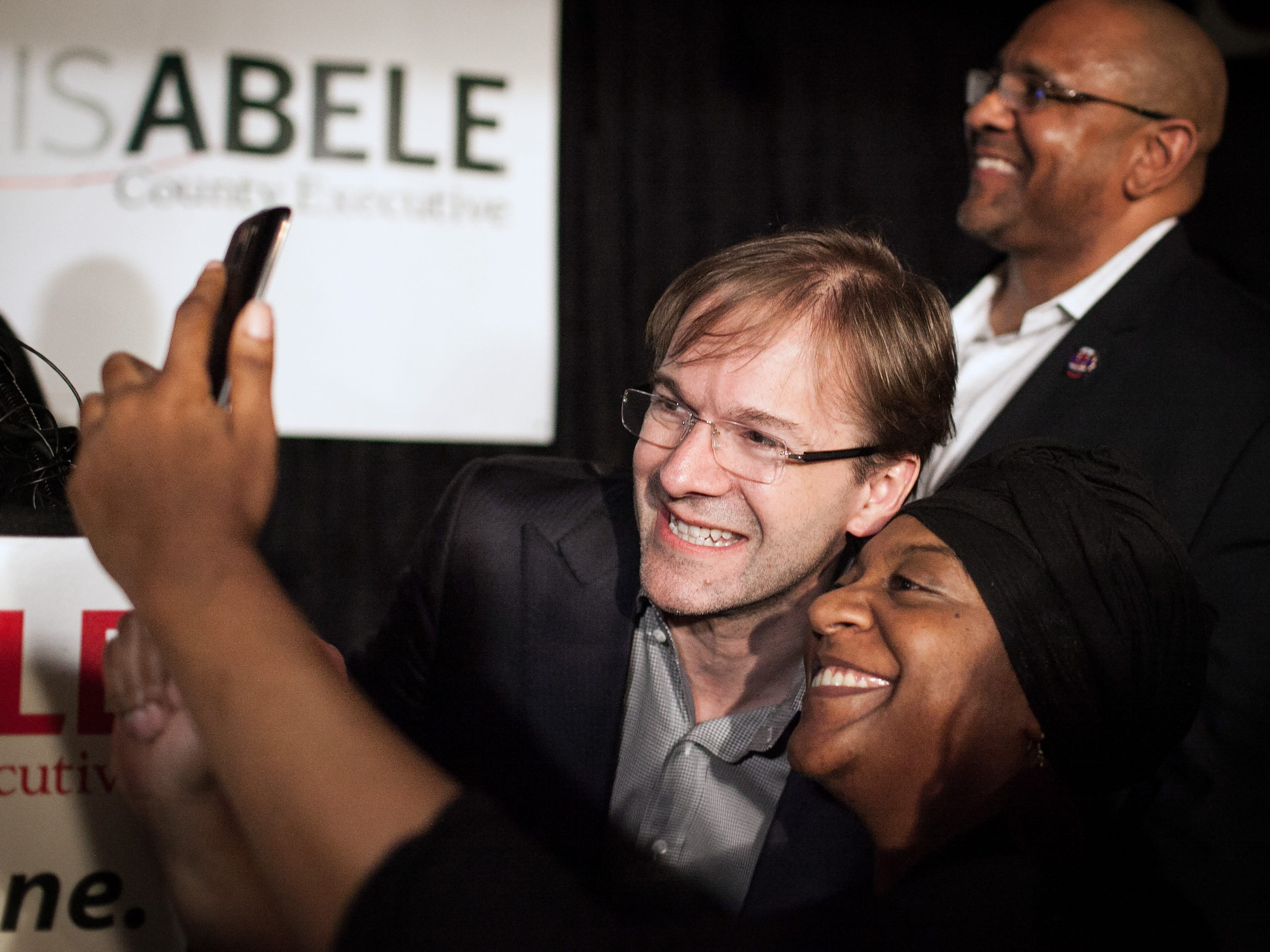 2016: Milwaukee County Executive Chris Abele takes a selfie with supporter Yazmene Thomas following his victory speech at Ugly's Pub in Milwaukee on April 5.