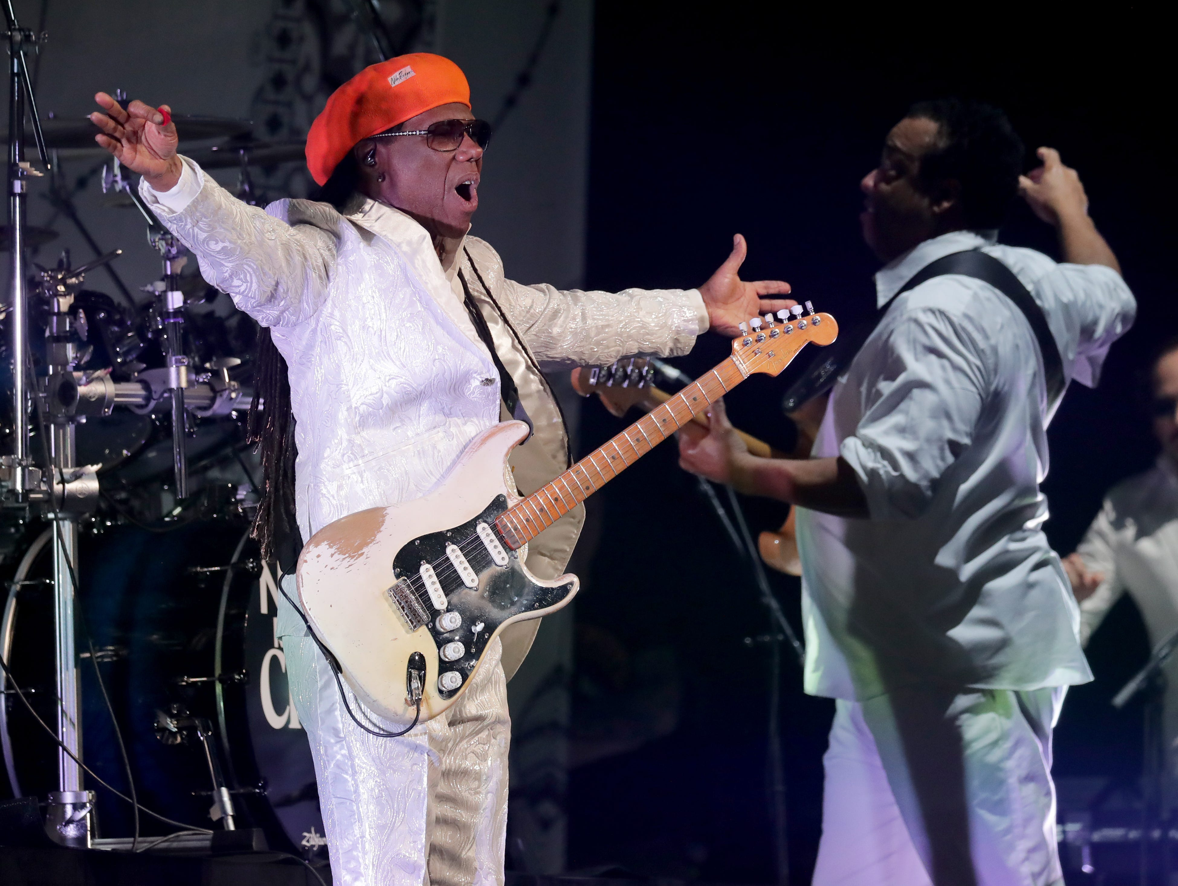 Nile Rodgers with Chic, who opened for Cher, performs at Fiserv Forum in Milwaukee on Sunday.