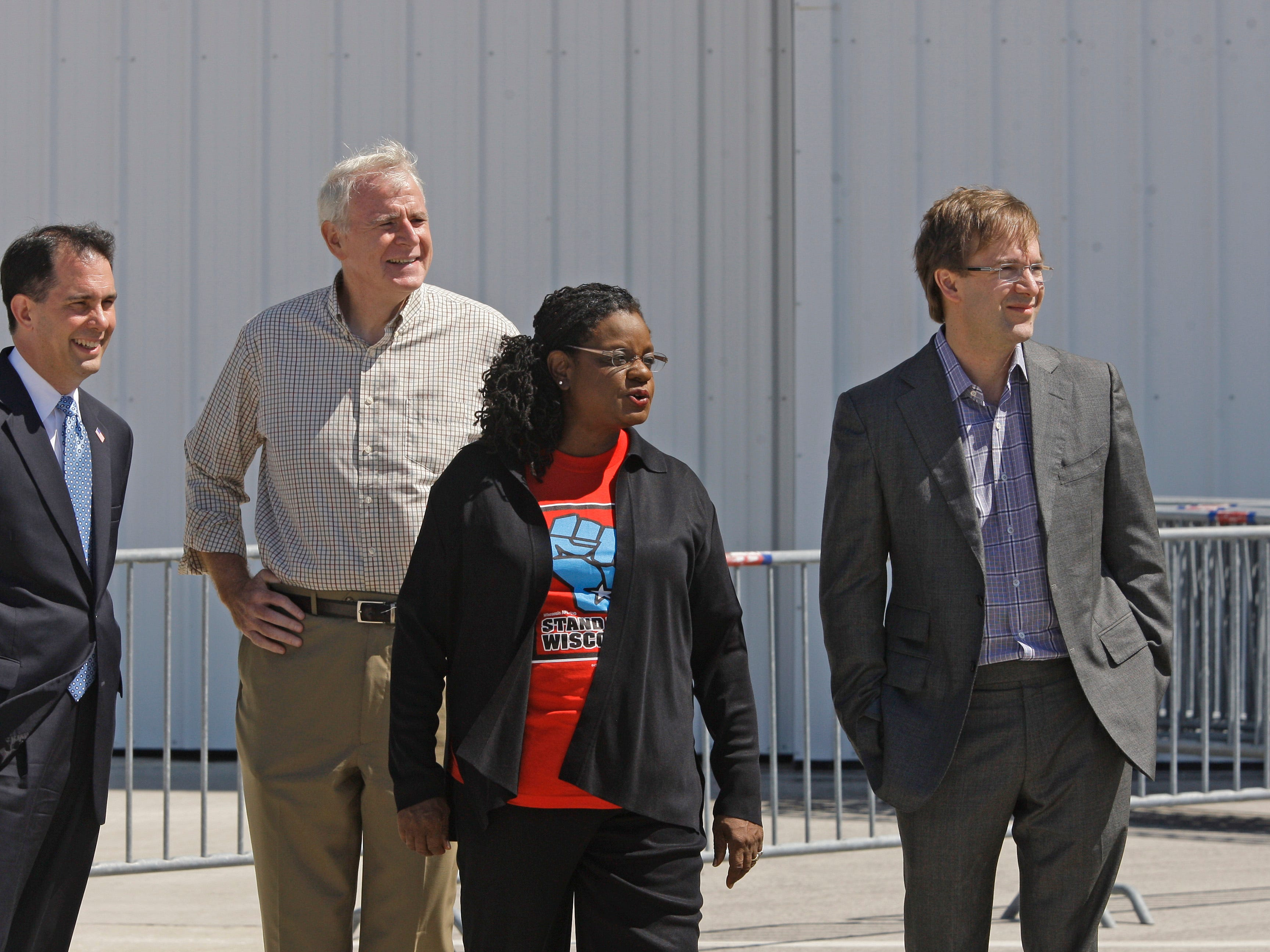 2014: Wisconsin political leaders, Gov. Scott Walker  ( left to right), Milwaukee Mayor Tom Barrett, Senator Gwen Moore and County Executive Chris Abele watch as Air Force One arrives with  President Barack Obama. The President was in town to speak at the Miller Lite Oasis Stage on the Summerfest grounds during Laborfest on Labor Day