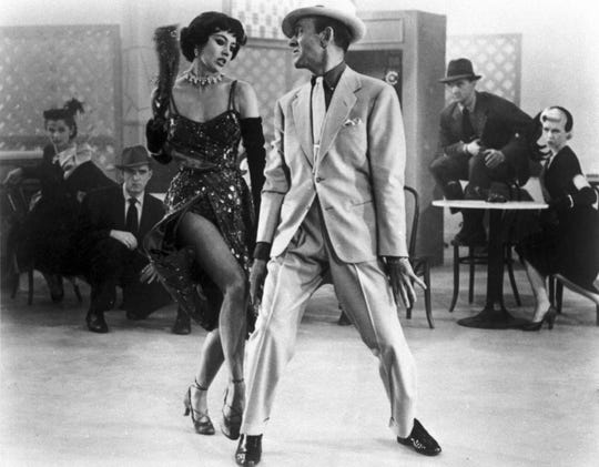 "Cyd Charisse (left) and Fred Astaire dance in a ballet number spoofing Mickey Spillane in the 1953 musical ""The Band Wagon."""