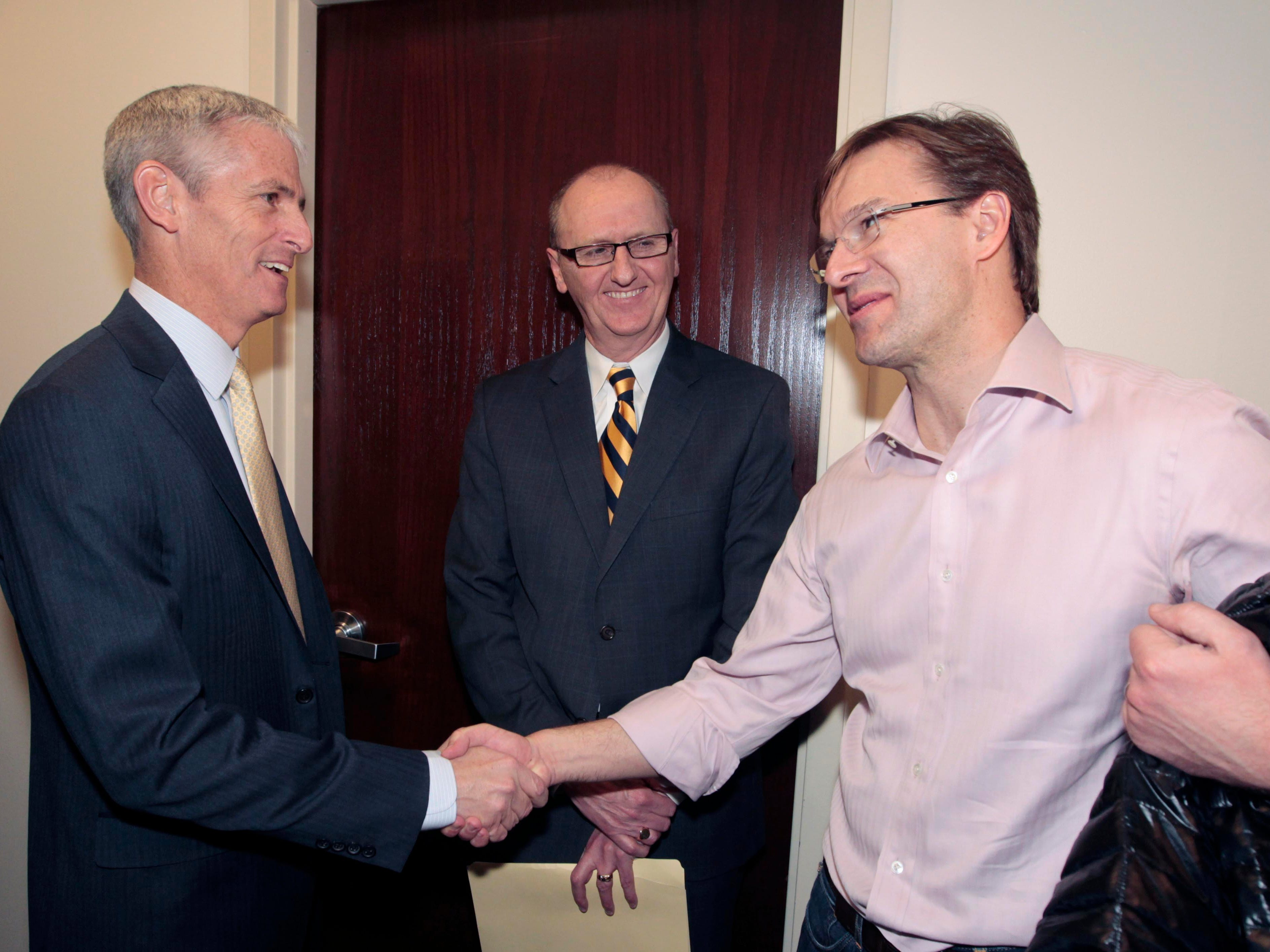 2014: Former University of Wisconsin-Milwaukee Chancellor Michael Lovell  greets Milwaukee County Executive Chris Abele after Lovell is introduced as the new president of Marquette  University.  He is the first layman to be president in the university's 132-year history.