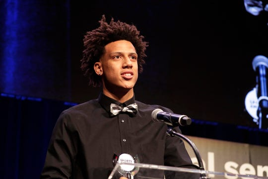 Nicolet's Jalen Johnson accepts his award for boys basketball player of the year during the third annual Journal Sentinel High School Sports Awards.