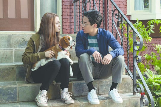 "CJ (Kathryn Prescott, left) and Trent (Henry Lau) bond with a little extra help from Bailey (voiced by Josh Gad) in ""A Dog's Journey."""