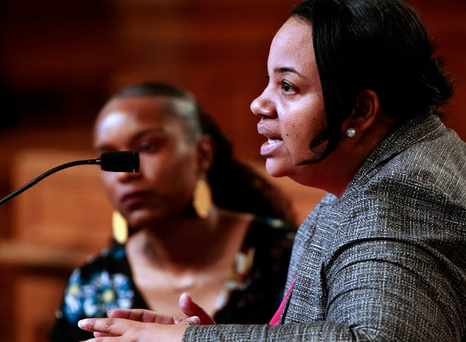 Milwaukee Ald. Milele Coggs, right, addresses the Common Council during a meeting at Milwaukee City Hall.