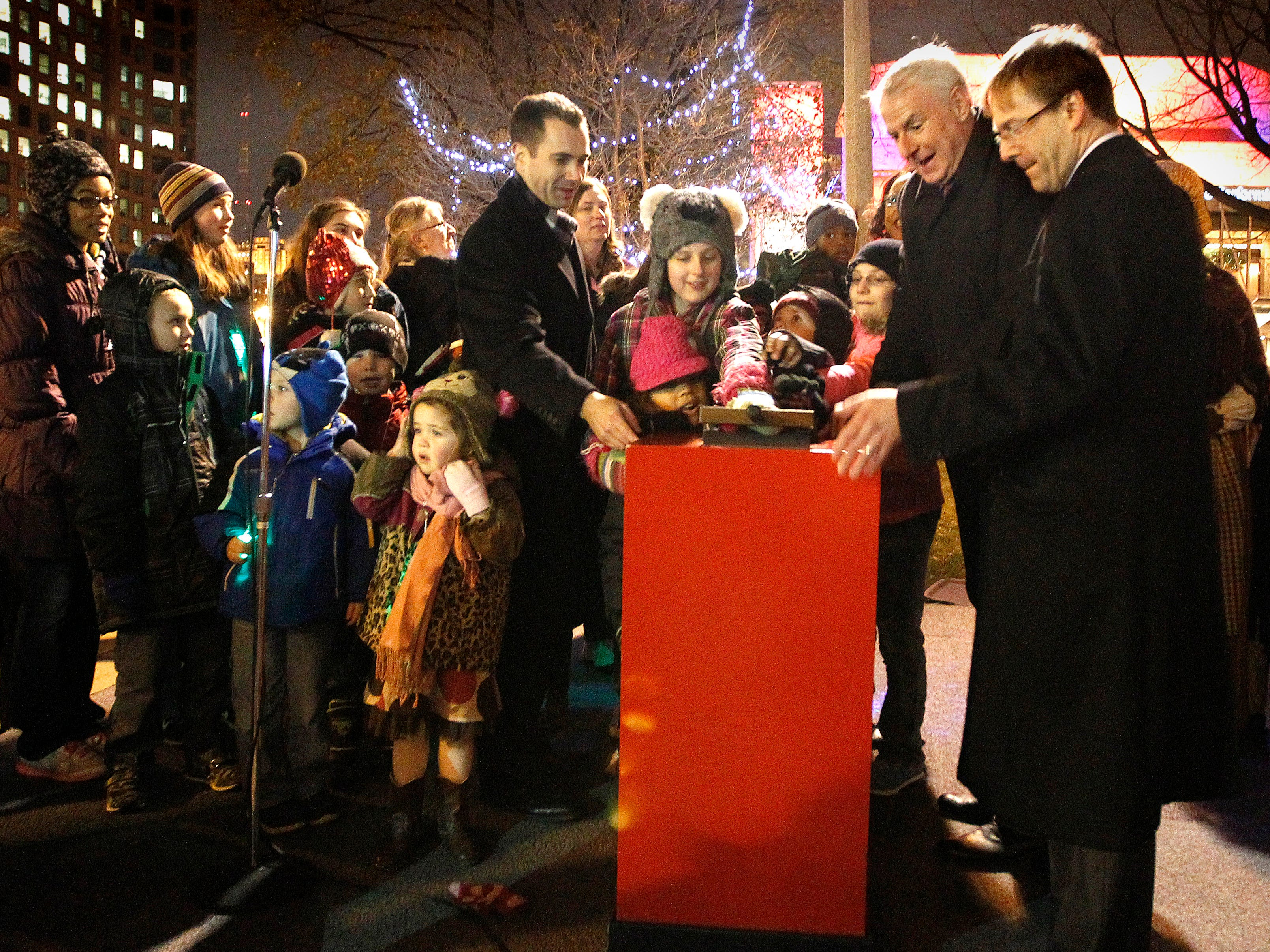 2013: Milwaukee Mayor Tom Barrett and County Executive Chris Abele throw the switch to light up Milwaukee's 100th year Christmas Tree celebration in Red Arrow Park. This years 40 foot Colorado Blue Spruce was donated by Loving Shepherd Lutheran Church and School.