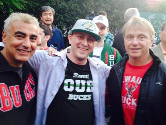 Paul Henning poses with Bucks owners (left) Marc Lasry and Wes Edens.