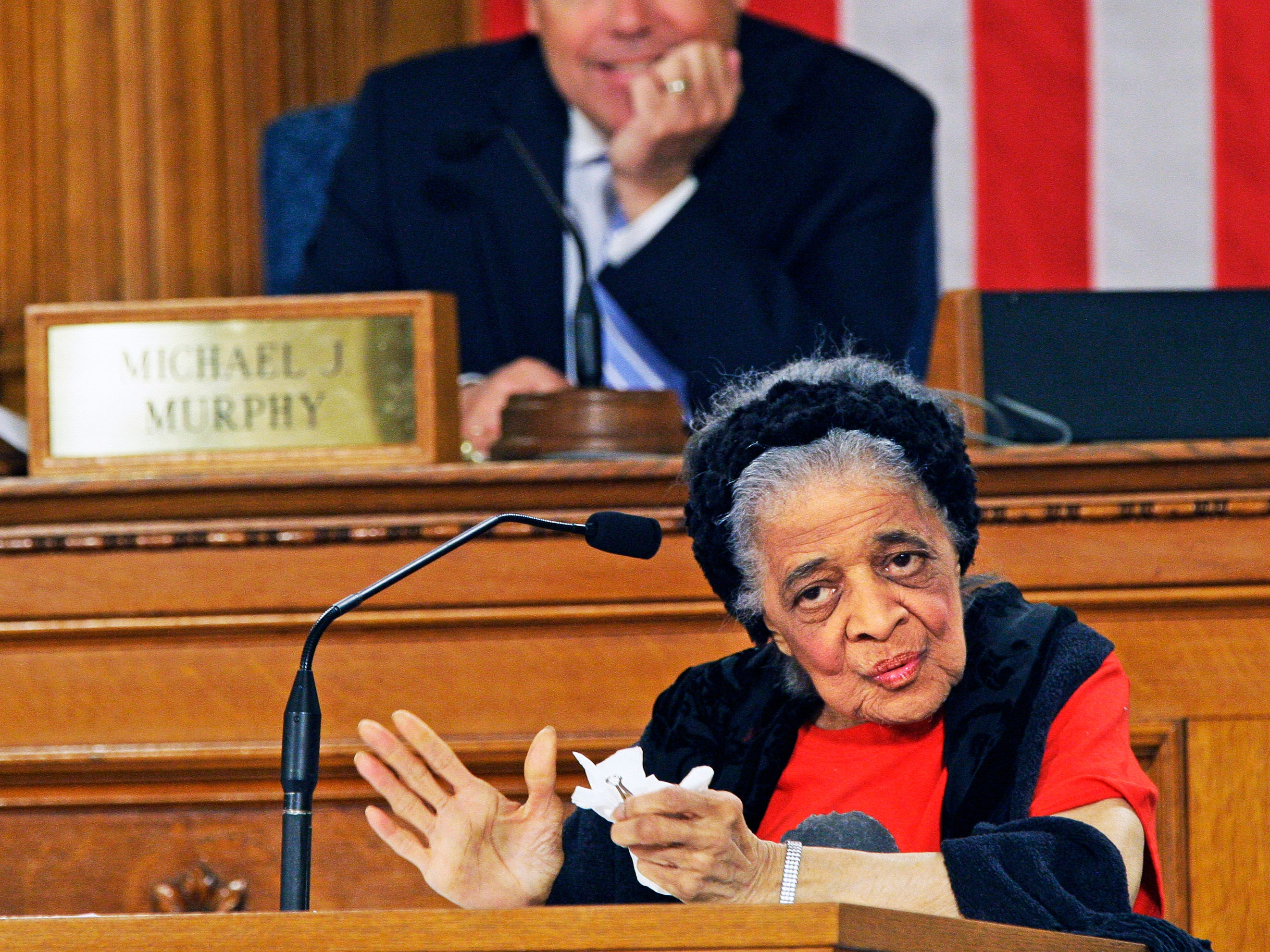 Vel Phillips, 90, speaks to the Common Council from the president's desk, while  Common Council President Michael Murphy looks on in this March 4, 2014 Journal Sentinel file photo. Phillips was being honored at the Common Council meeting at Milwaukee City Hall for her many years as a civil rights advocate and her historical contribution to the city of Milwaukee.  Phillips paved the way as  the first woman and first African American woman in the Milwaukee Common Council. She died in 2018.