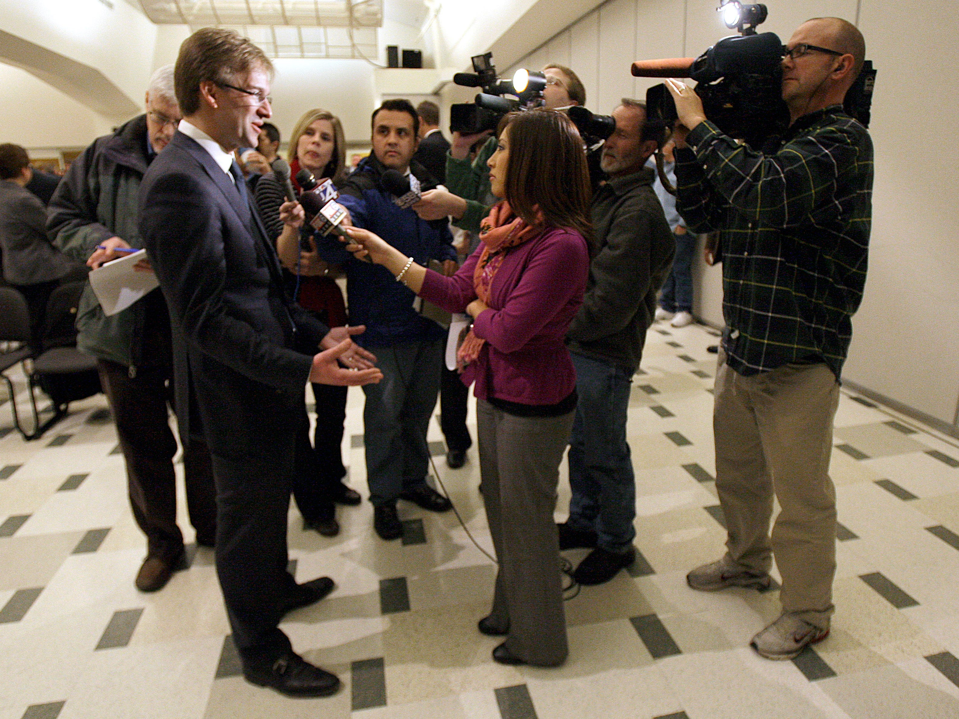 """2012: Milwaukee County Executive Chris Abele (left) talks to the media after delivering his first """"State of the County"""" speech at the University of Wisconsin Milwaukee Ballroom on February 27."""
