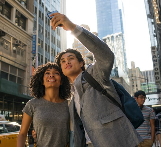 "Yara Shahidi (left) and Charles Melton play star-crossed maybe-lovers on the clock in ""The Sun Is Also a Star."""