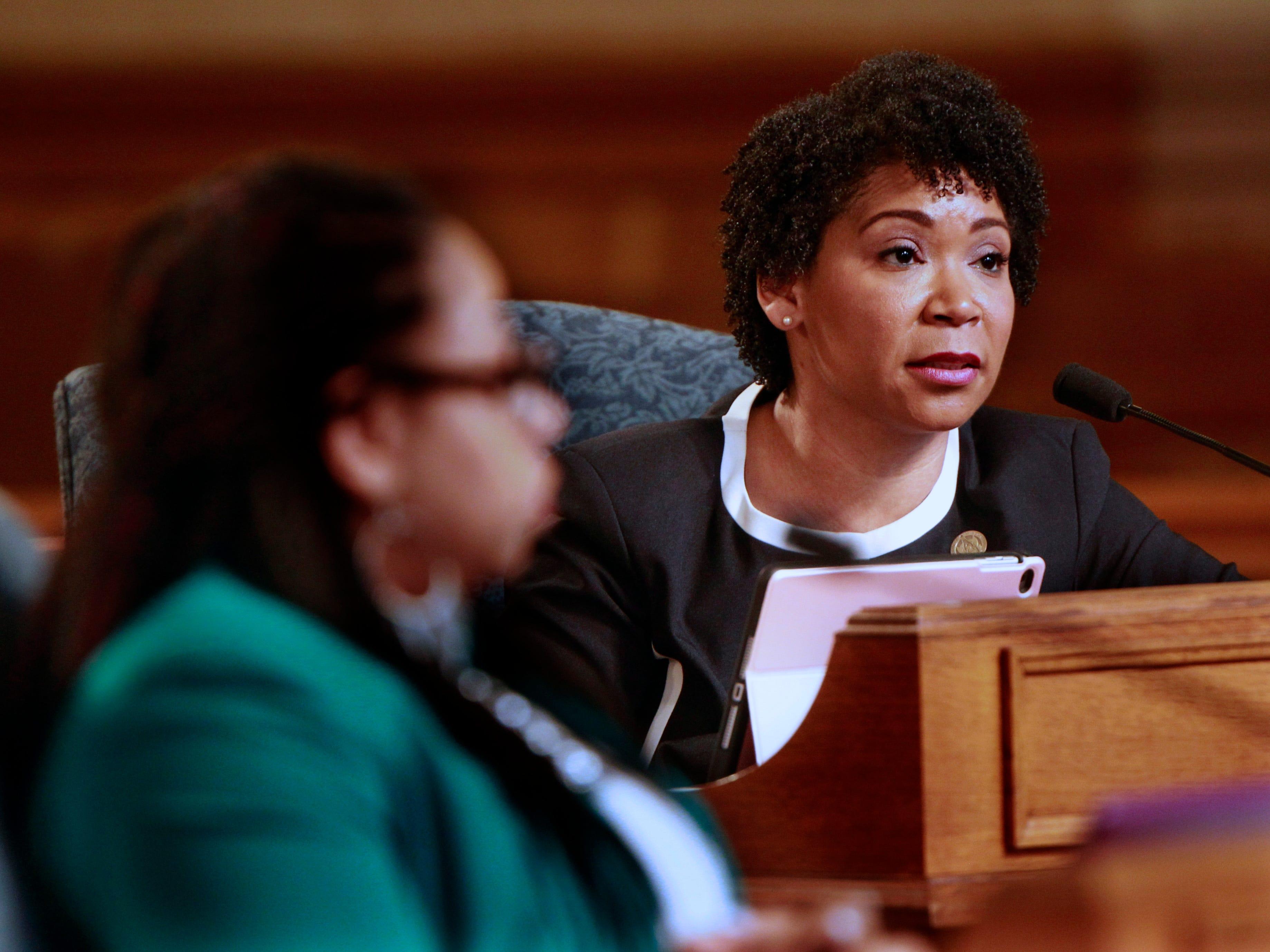 Milwaukee Alderwoman Nikiya Dodd, right, addresses the Common Council during a meeting at Milwaukee City Hall.