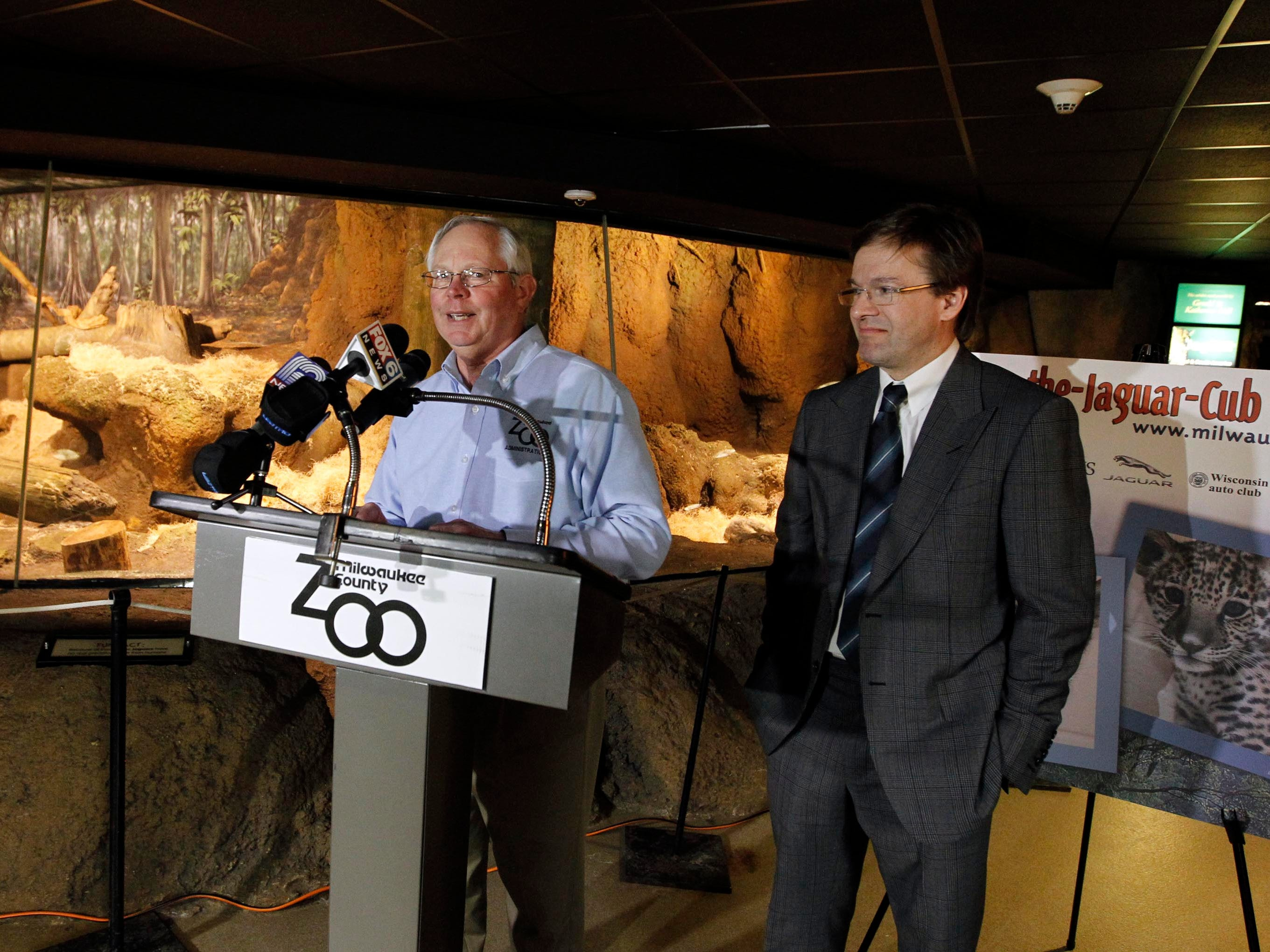 2013: Charles Wickenhauser, Director of the Milwaukee County Zoo and County Executive Chris Abele introduce jaguar cubs and their new public display space at the The Milwaukee County Zoo.