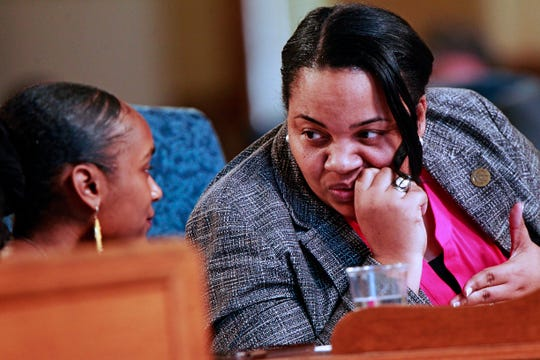 Milwaukee Alderwoman Milele Coggs, right, confers with Youth Council President Bria Smith at a Common Council meeting at Milwaukee City Hall.