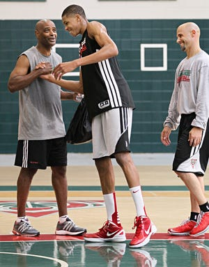 Assistant coach Josh Oppenheimer, right, worked with then-rookie Giannis Antetokounmpo, center, in 2013.
