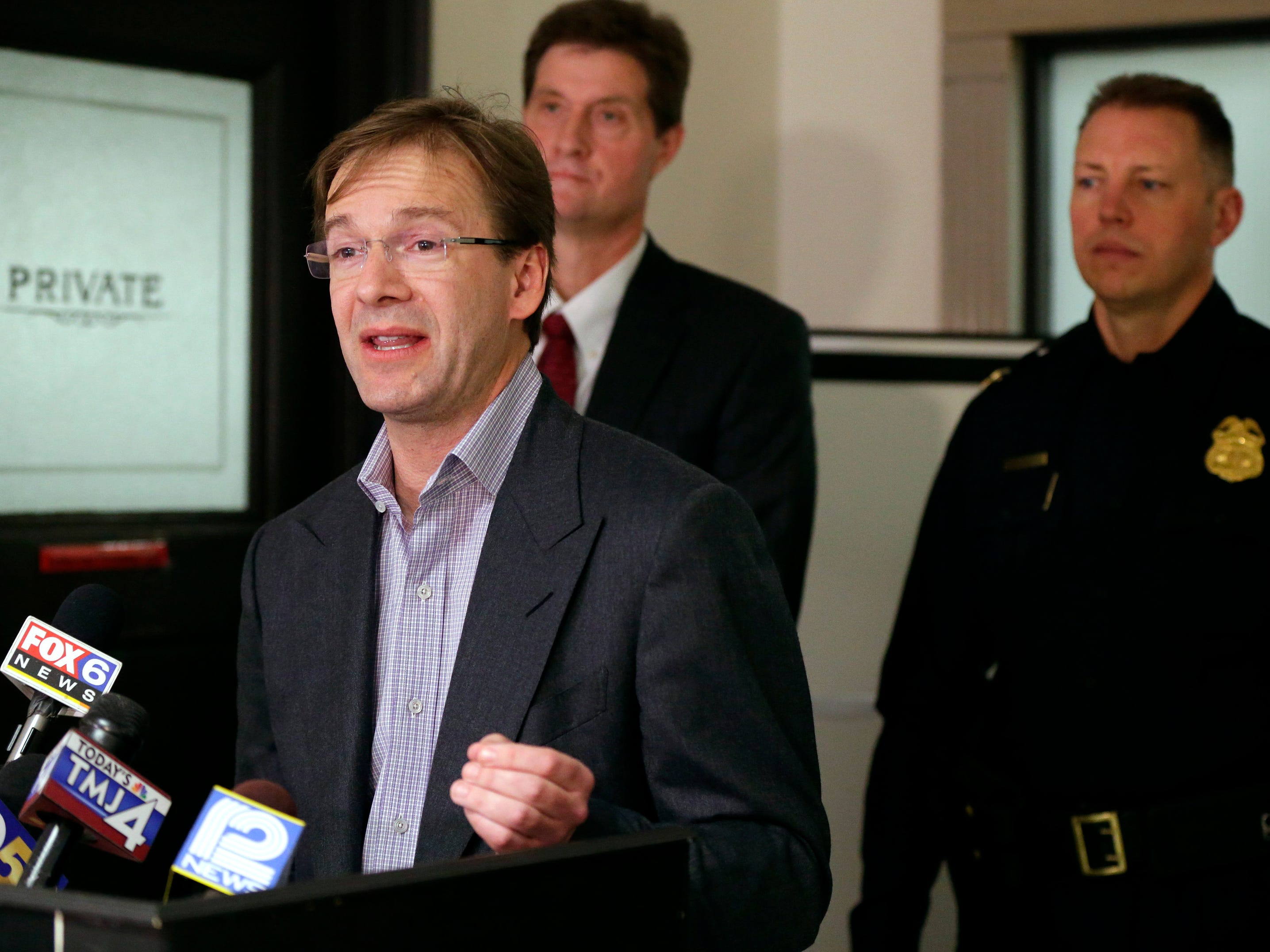 2015: Milwaukee County executive Chris Abele speaks at a news conference in the Milwaukee County Courthouse on  November 12,  to discuss the charging of four people in a plot to kill a homicide witness.