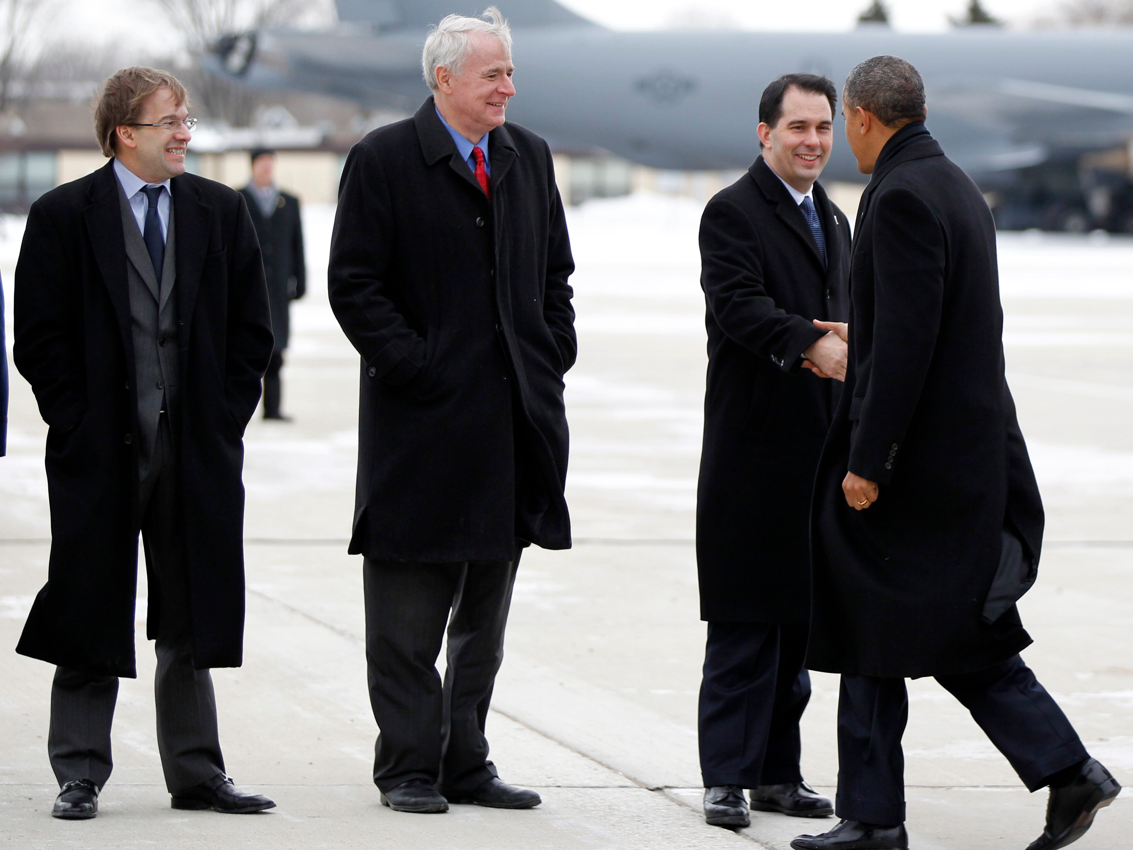 2014: President Barack Obama is greeted by Gov. Scott Walker, Milwaukee County Executive Chris Abele (far left) an Milwaukee Mayor Tom Barrett at General Mitchell International Airport on January 30. President Obama spoke at GE Energy in Waukesha. The visit is part of a four-state tour the president is making following his State of the Union speech.
