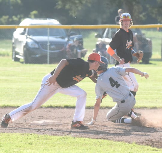 Viola's Caden Meredith applies a tag to Izard County's Chase Orf during regional tournament action last week. The Longhorns defeated Armorel 10-0 Sunday to advance to the state championship game.