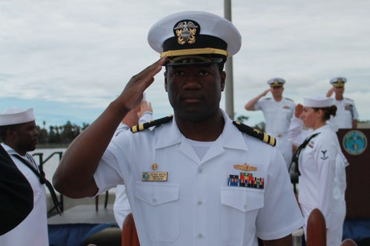 Lt. Antionne Winston is piped ashore after assuming command of Coastal Riverine Squadron Three Bravo Company Crew One during an assumption of command ceremony onboard Naval Amphibious Base Coronado. Winston is the second ever naval officer to assume command of a Mk VI patrol boat and its crew.