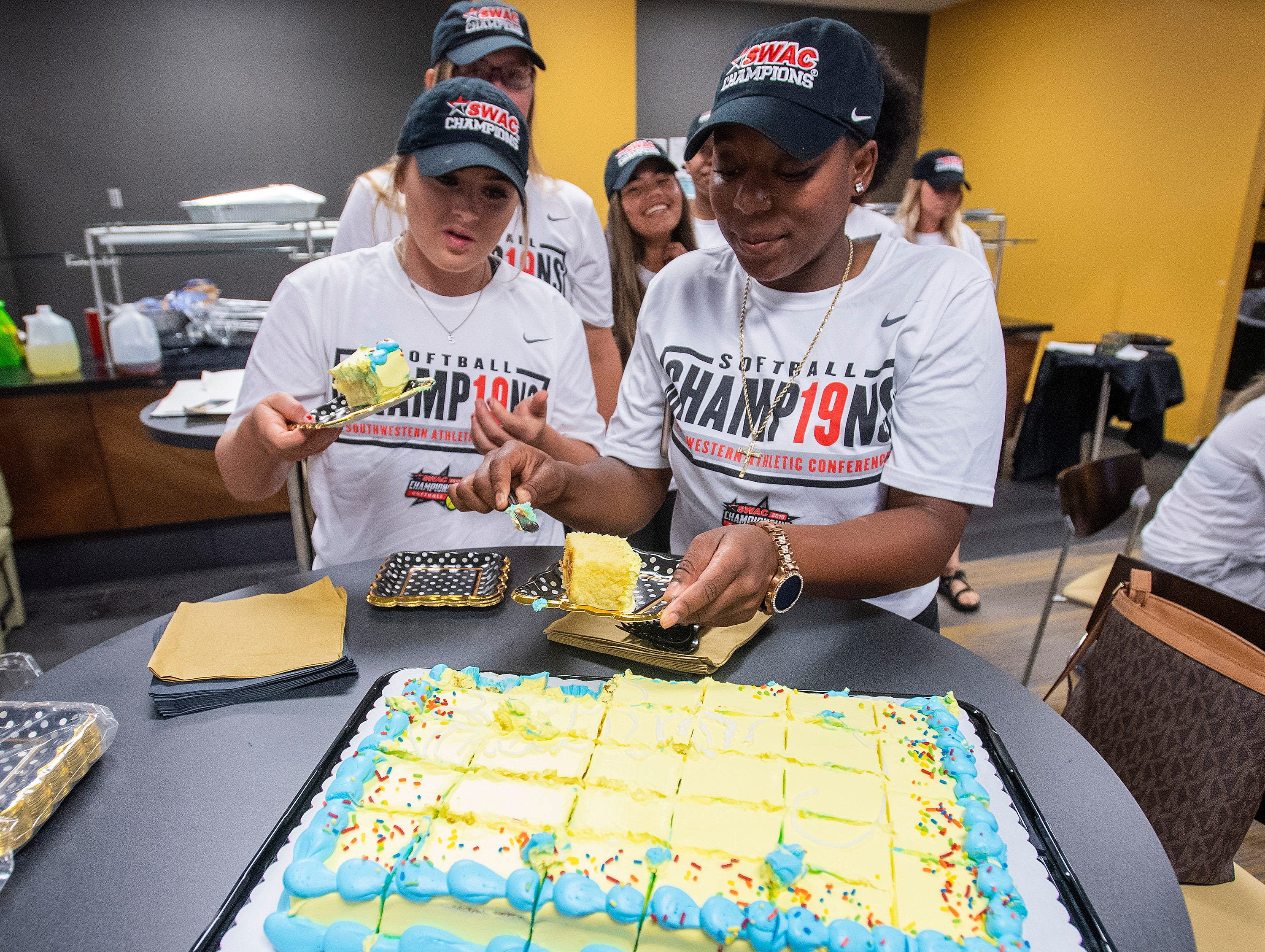 The Alabama State University Softball players get cake after eating during a watch party, on the ASU campus in Montgomery, Ala., on Sunday evening May 12, 2019, to see where they will play in the NCAA Softball Tournament. ASU plays Alabama in Tuscaloosa.