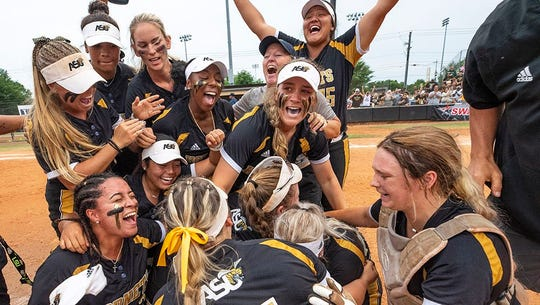 The Alabama State softball team celebrates winning the SWAC Tournament.