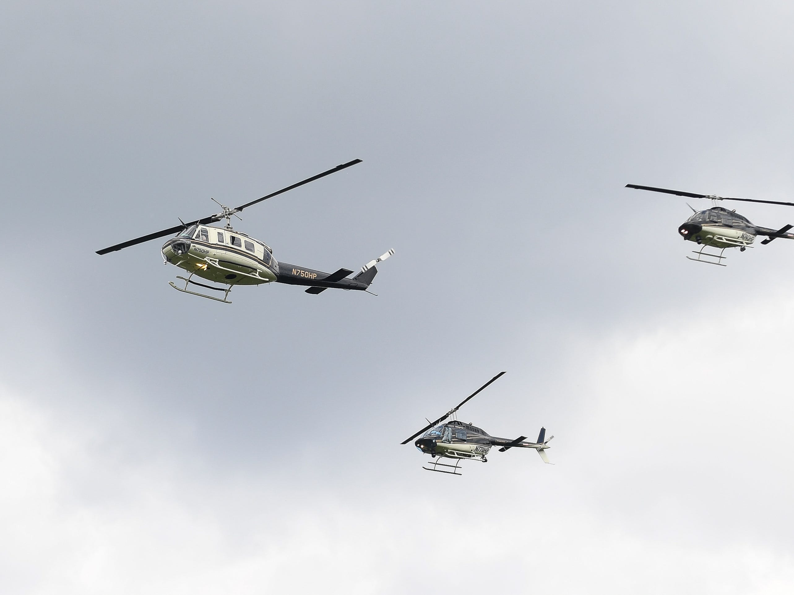Tennessee Highway Patrol helicopters perform a flyover during the burial of Tennessee State Trooper Matthew Gatti at Ridgecrest Cemetery in Jackson, Tenn., Monday, May 13, 2019. Gatti died in the line of duty in an accident while responding to a car fire on I-40 in Madison County on May 6.