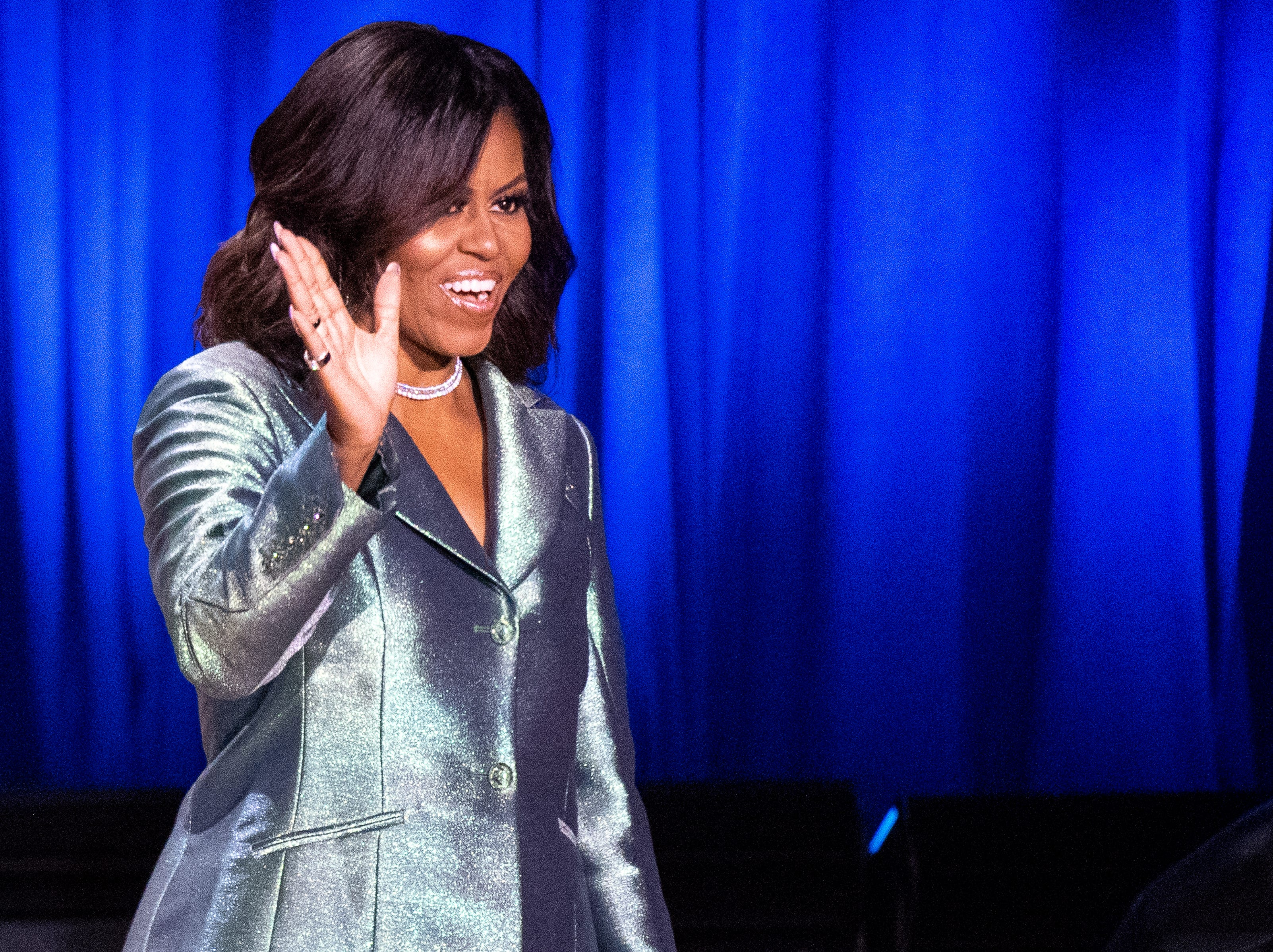 Michelle Obama walks on stage during her Becoming: An Intimate Conversation with Michelle Obama event at Ryman Auditorium Sunday, May 12, 2019, in Nashville, Tenn.