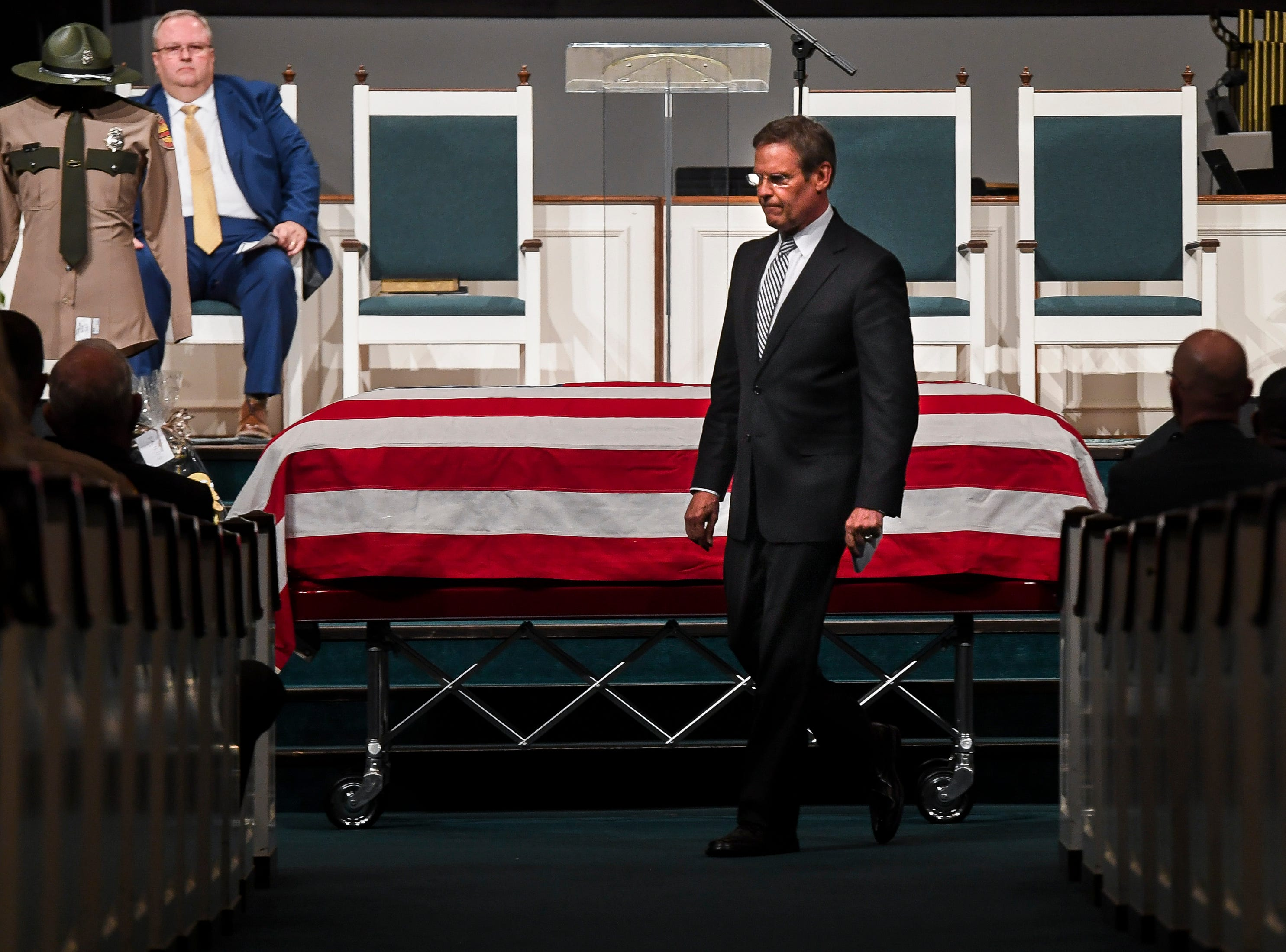 Tennessee Governor Bill Lee heads back to his seat after delivering remarks during the funeral service for Tennessee State Trooper Matthew Gatti at West Jackson Baptist Church in Jackson, Tenn., Monday, May 13, 2019. Gatti died in the line of duty in an accident while responding to a car fire on I-40 in Madison County on May 6.