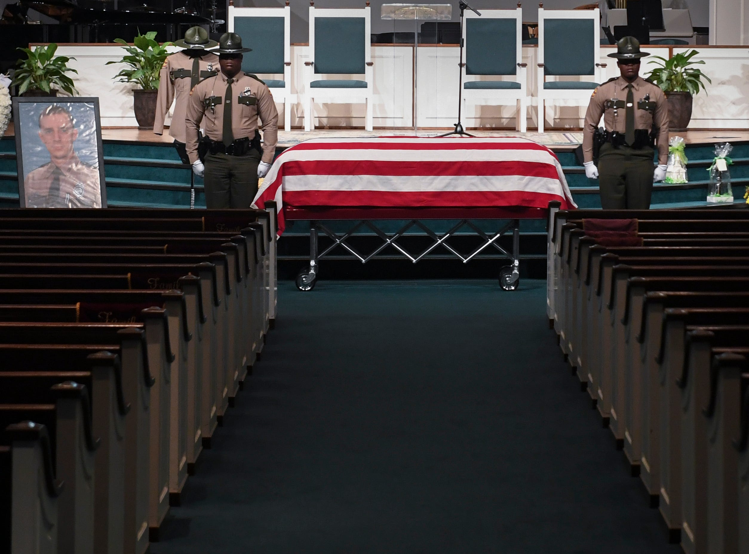 Tennessee State Troopers stand guard next to the casket before the funeral service for Tennessee State Trooper Matthew Gatti at West Jackson Baptist Church in Jackson, Tenn., Monday, May 13, 2019. Gatti died in the line of duty in an accident while responding to a car fire on I-40 in Madison County on May 6.