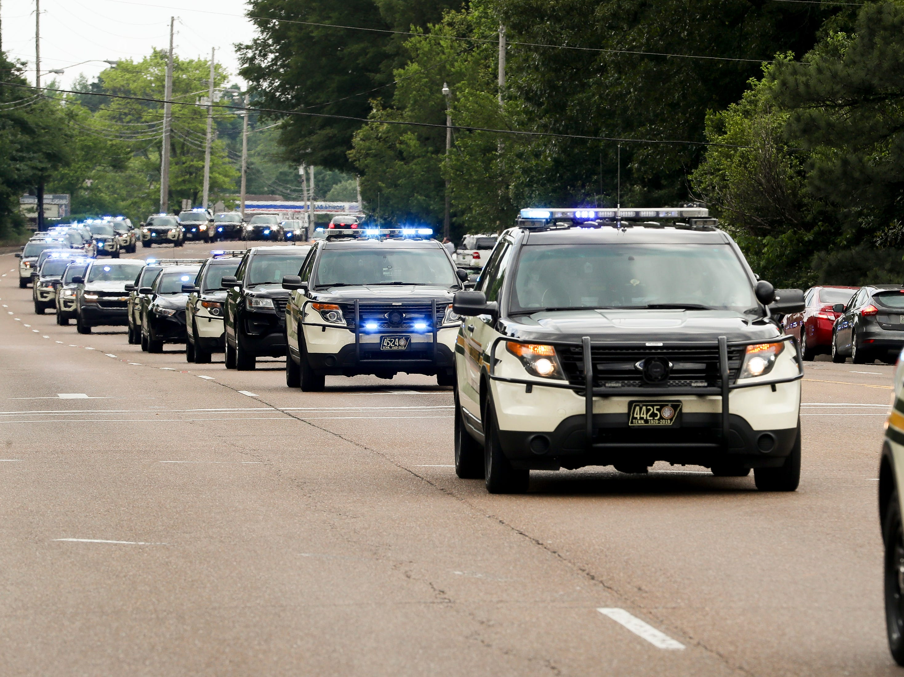 The funeral procession for Tennessee State Trooper Matthew Gatti passes down U.S. Route 45 in Jackson, Tenn., Monday, May 13, 2019. Gatti died in the line of duty in an accident while responding to a car fire on I-40 in Madison County on May 6.