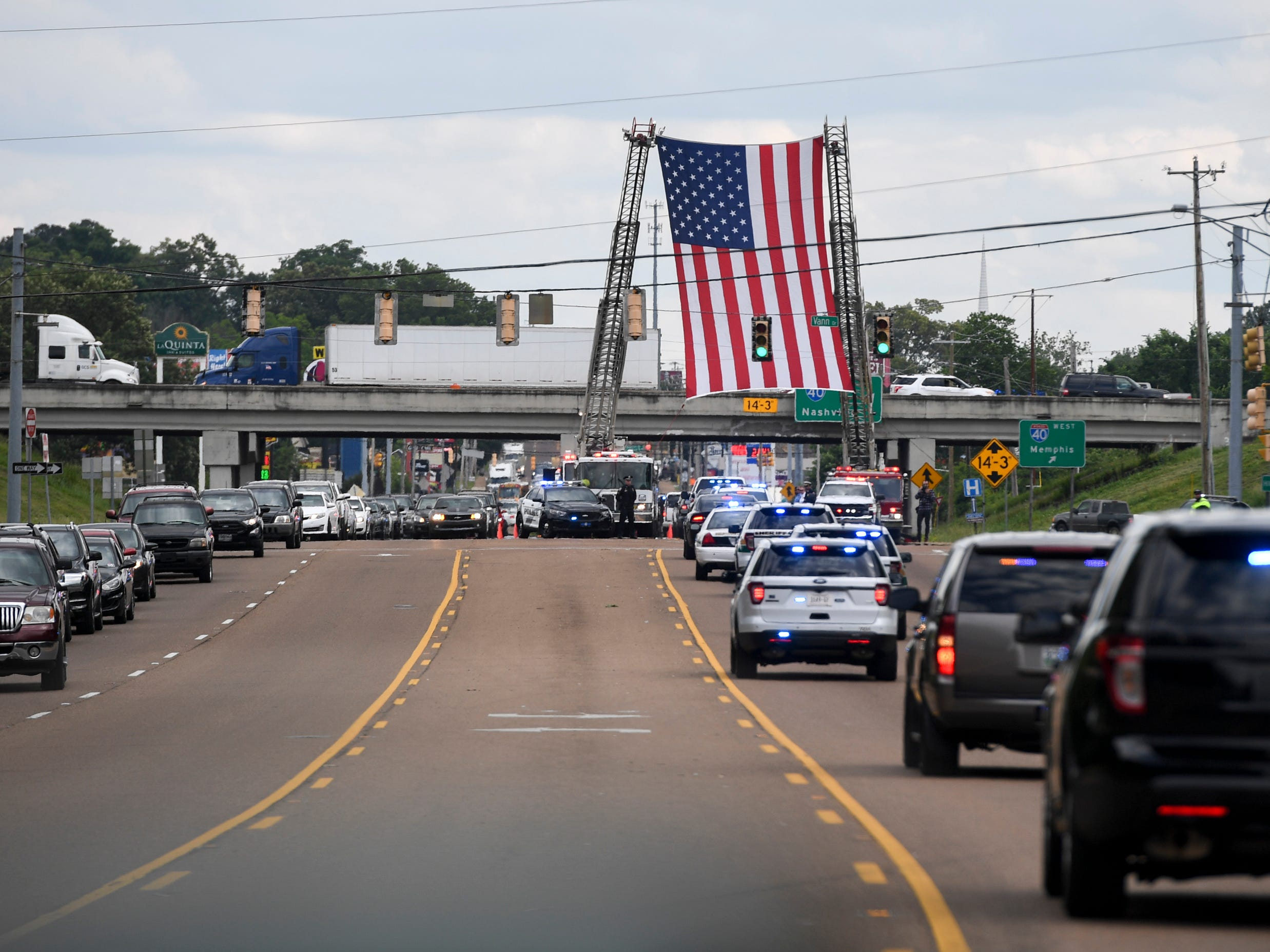 The funeral procession for Tennessee State Trooper Matthew Gatti passes through Jackson, Tenn., Monday, May 13, 2019. Gatti died in the line of duty in an accident while responding to a car fire on I-40 in Madison County on May 6.