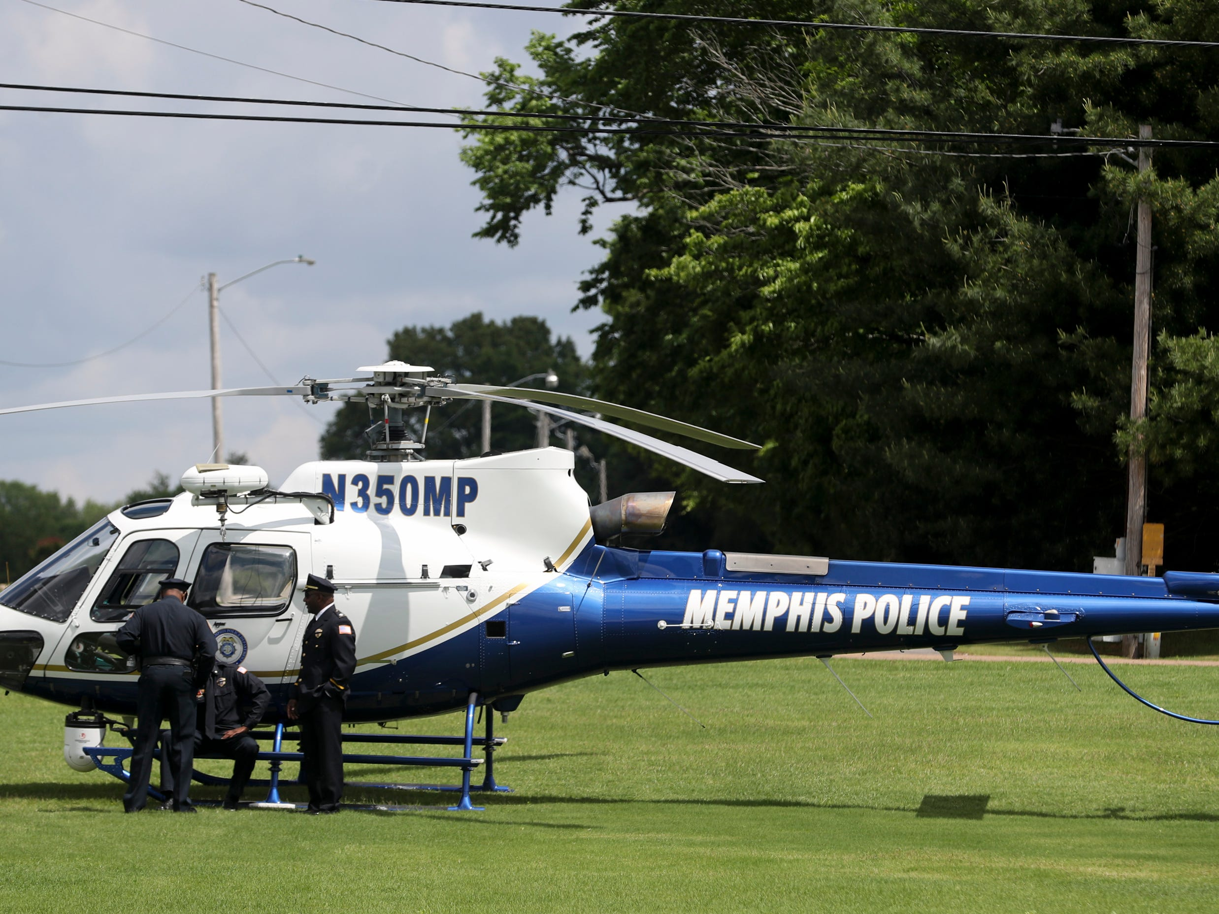 A Memphis Police helicopter is seen outside of the church before the funeral service for Tennessee State Trooper Matthew Gatti at West Jackson Baptist Church in Jackson, Tenn., Monday, May 13, 2019. Gatti died in the line of duty in an accident while responding to a car fire on I-40 in Madison County on May 6.
