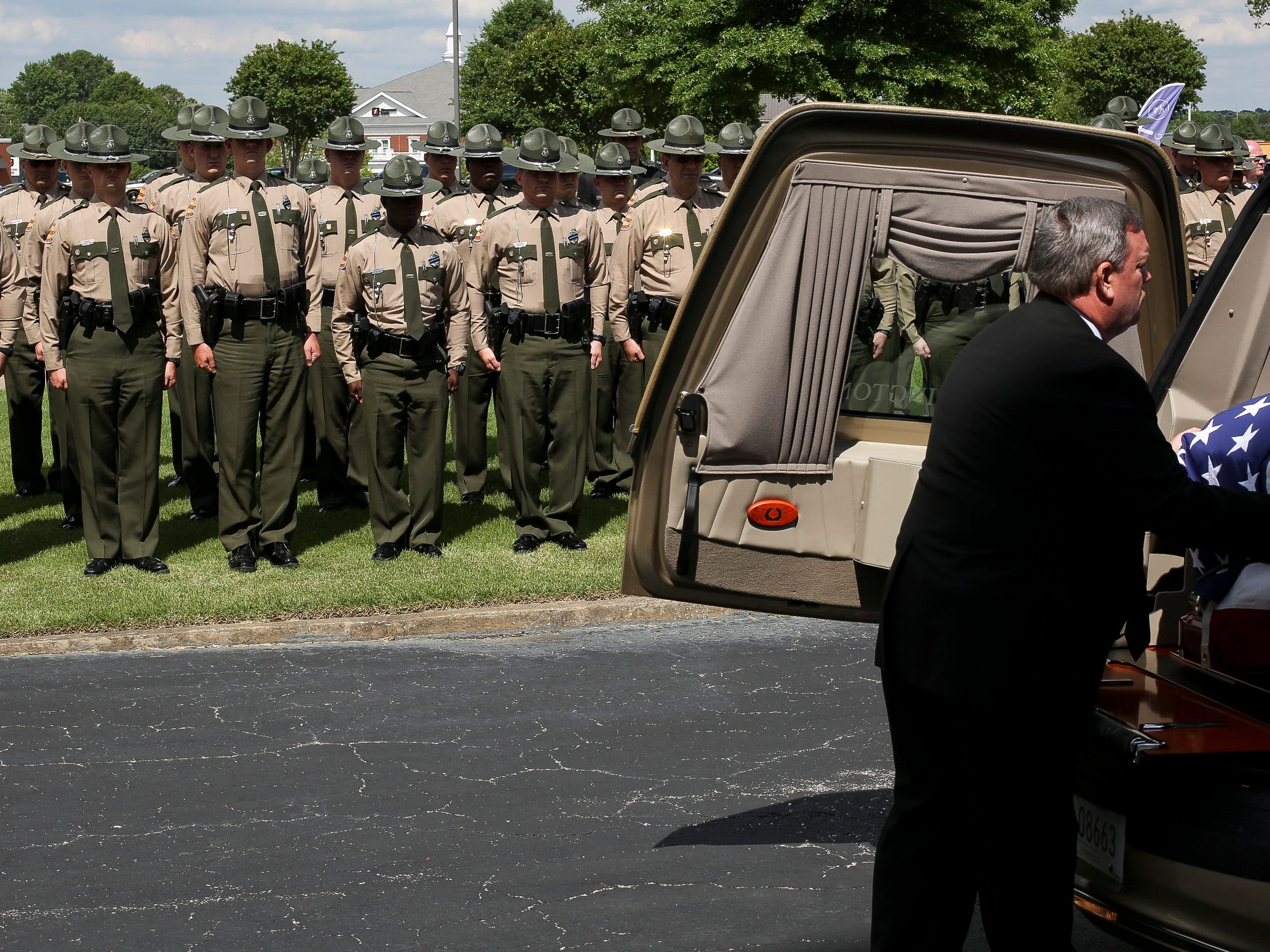 The casket is placed in the hearse after the funeral service for Tennessee State Trooper Matthew Gatti at West Jackson Baptist Church in Jackson, Tenn., Monday, May 13, 2019. Gatti died in the line of duty in an accident while responding to a car fire on I-40 in Madison County on May 6.